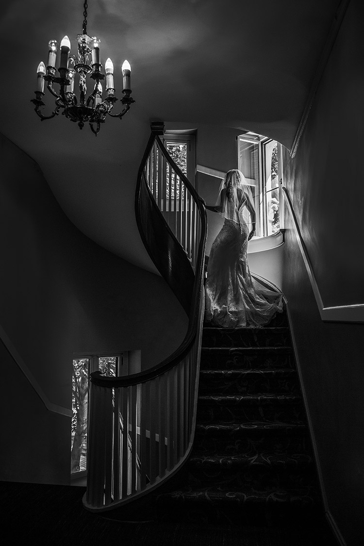 Bride ascending stairs in silk dress,  photo by Amber Henry Photography