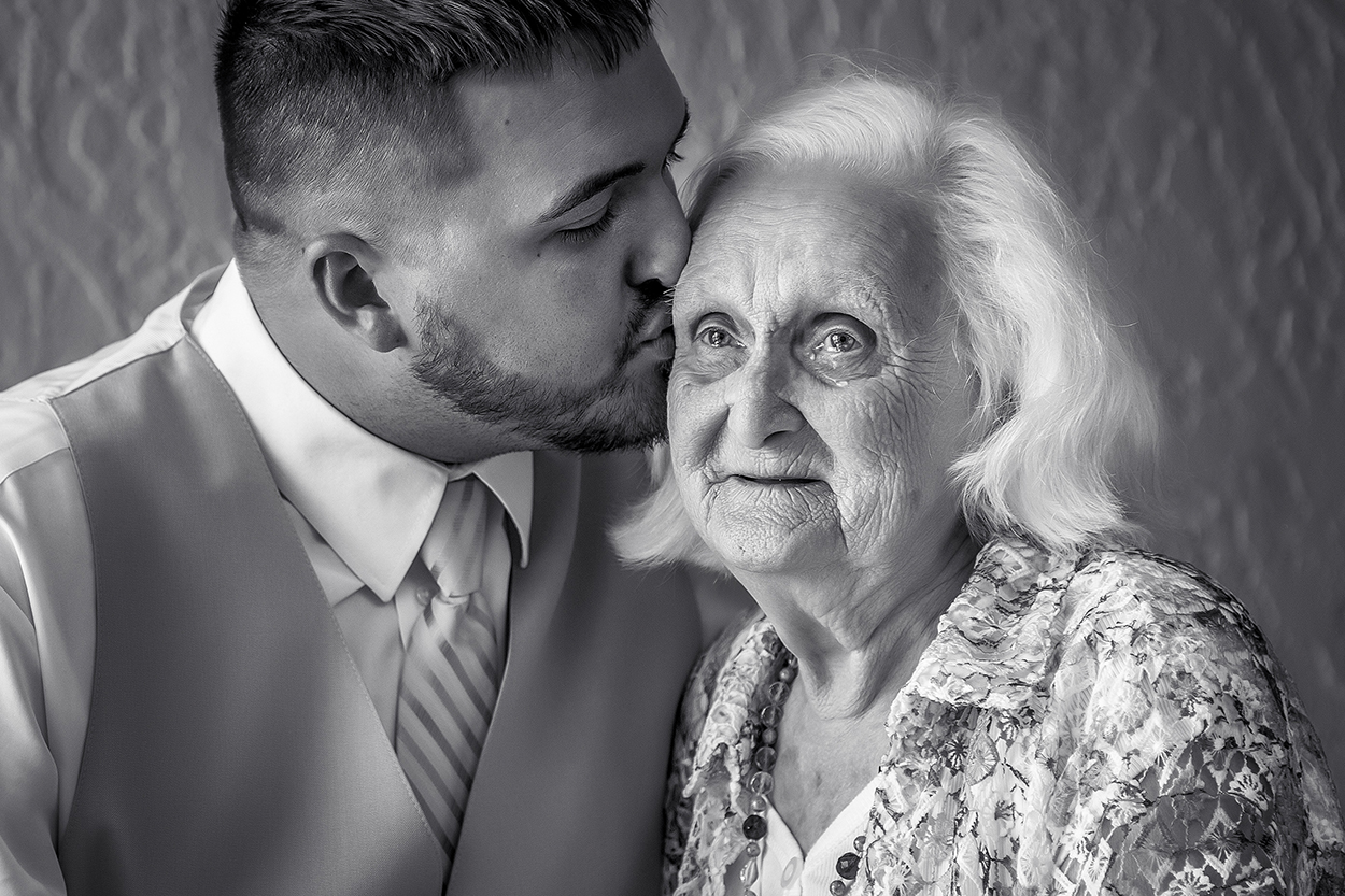 Grandmother crying while groom gives her a kiss, photo by Amber Henry Photograph