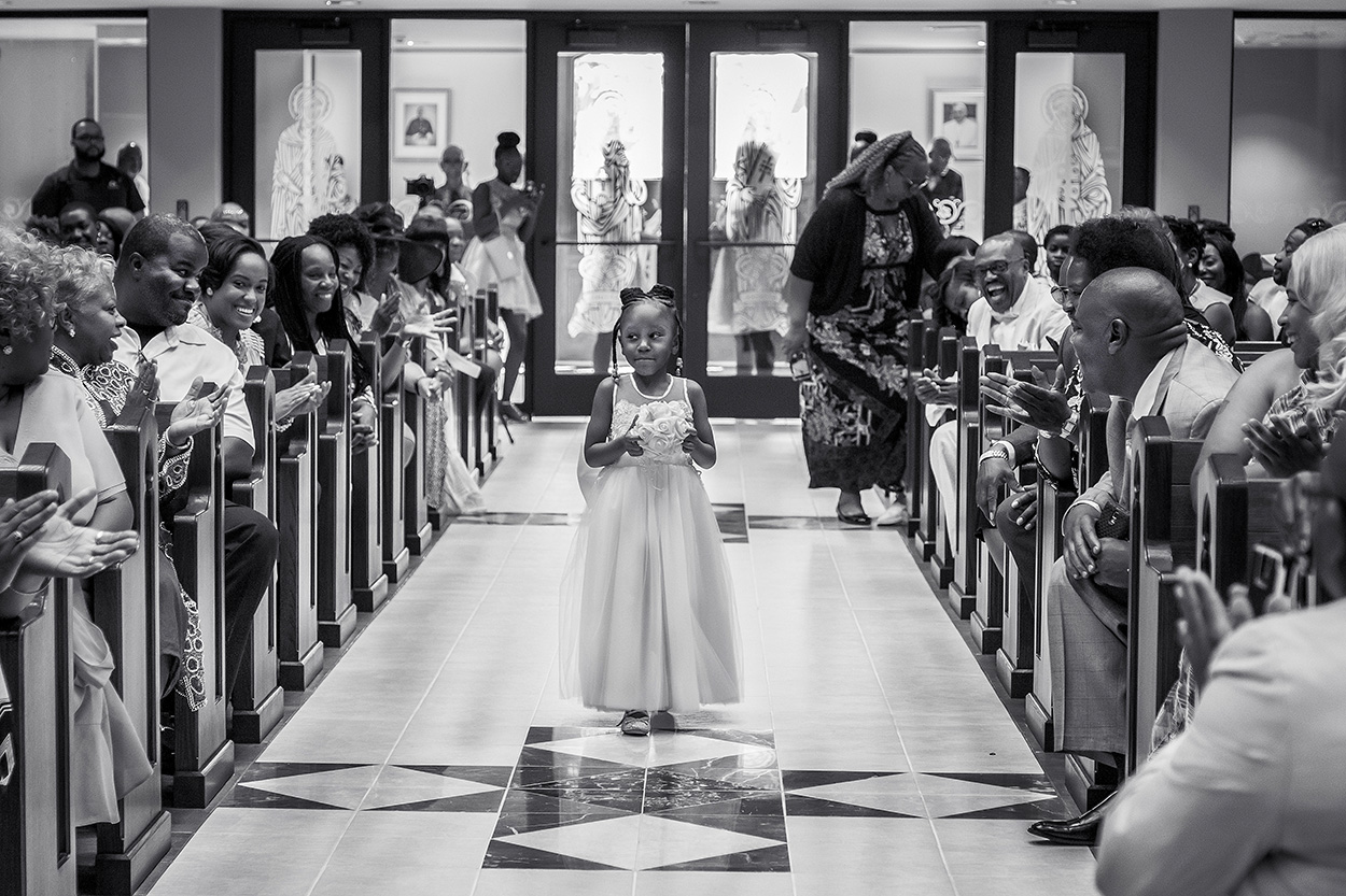 Little flower girl comes down the aisle, photo by Amber Henry Photography, Michigan
