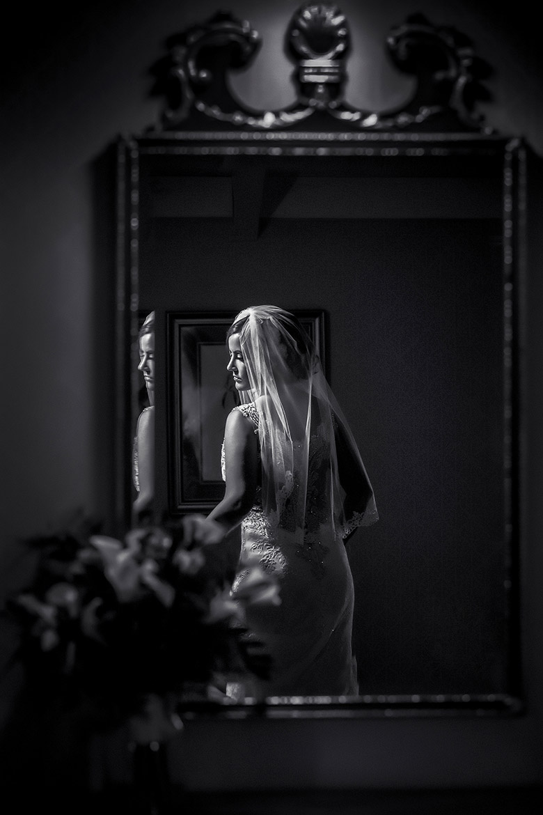 Portrait of bride in mirror by Amber Henry Photography, Michigan