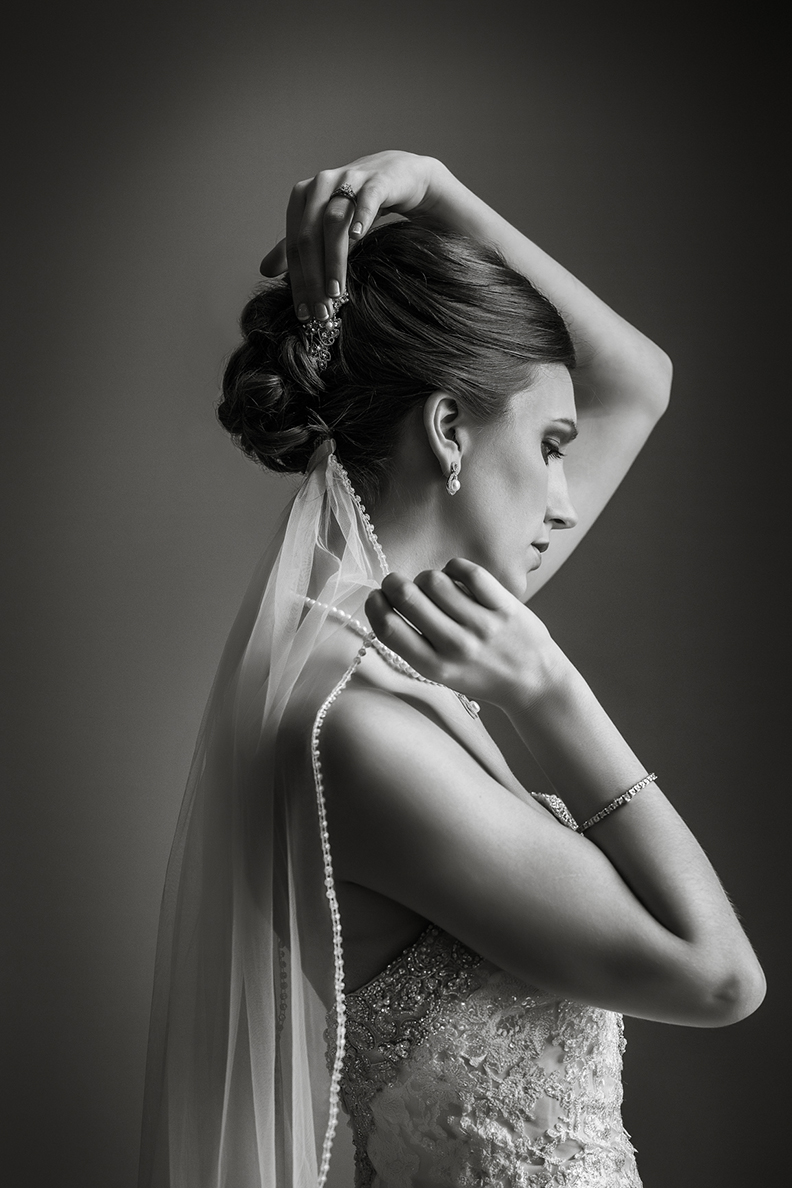 Portrait of brunette bride with updo and pearl edged veil by Amber Henry Photography, Michigan