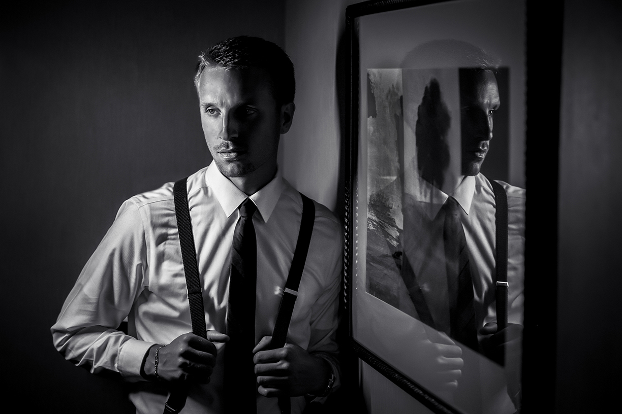 Portrait of groom reflected in glass - Amber Henry Photography Michigan