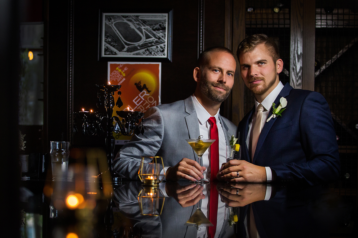 Portrait of grooms with manhattans by Amber Henry Photography, Michigan