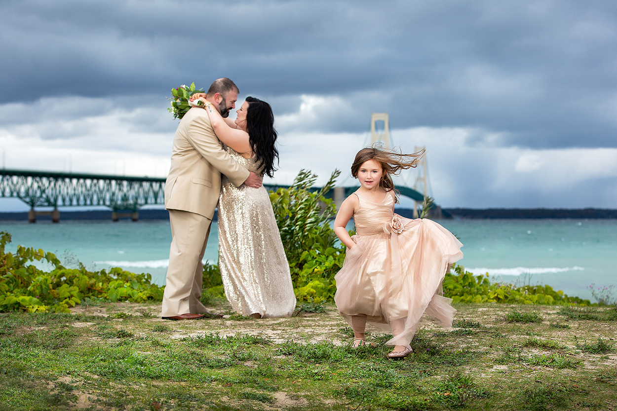 Portrait of little girl running towards camera during bridal session by Amber Henry Photography, Michigan