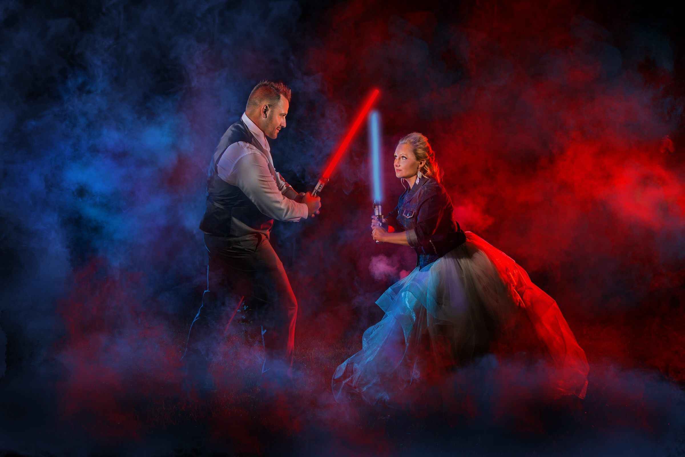 Couple play fighting with Star Wars light sabers - photo by Amber Henry - Michigan