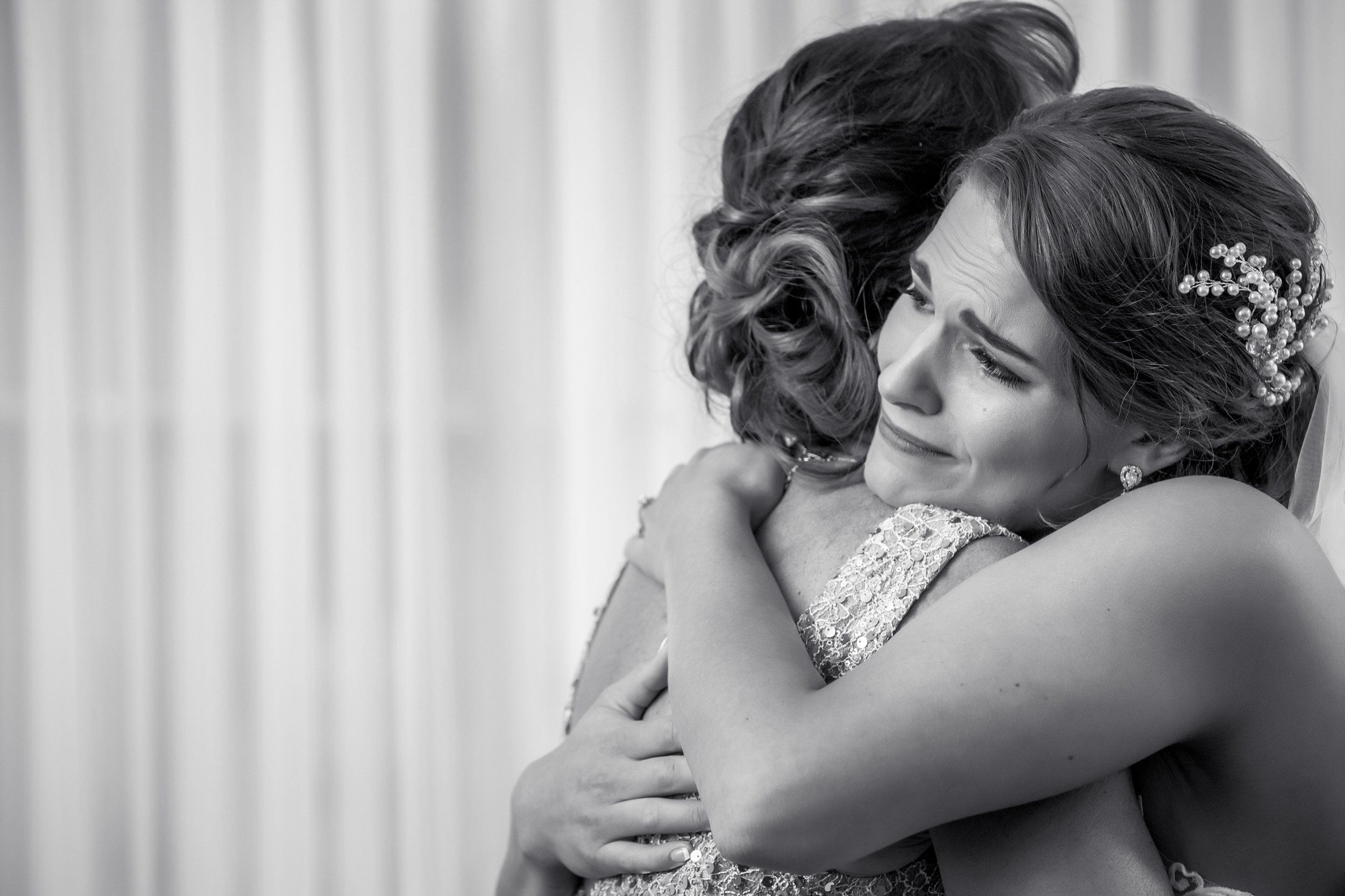 Photo of bride hugging her mom by Amber Henry Photography - Detroit, Michigan