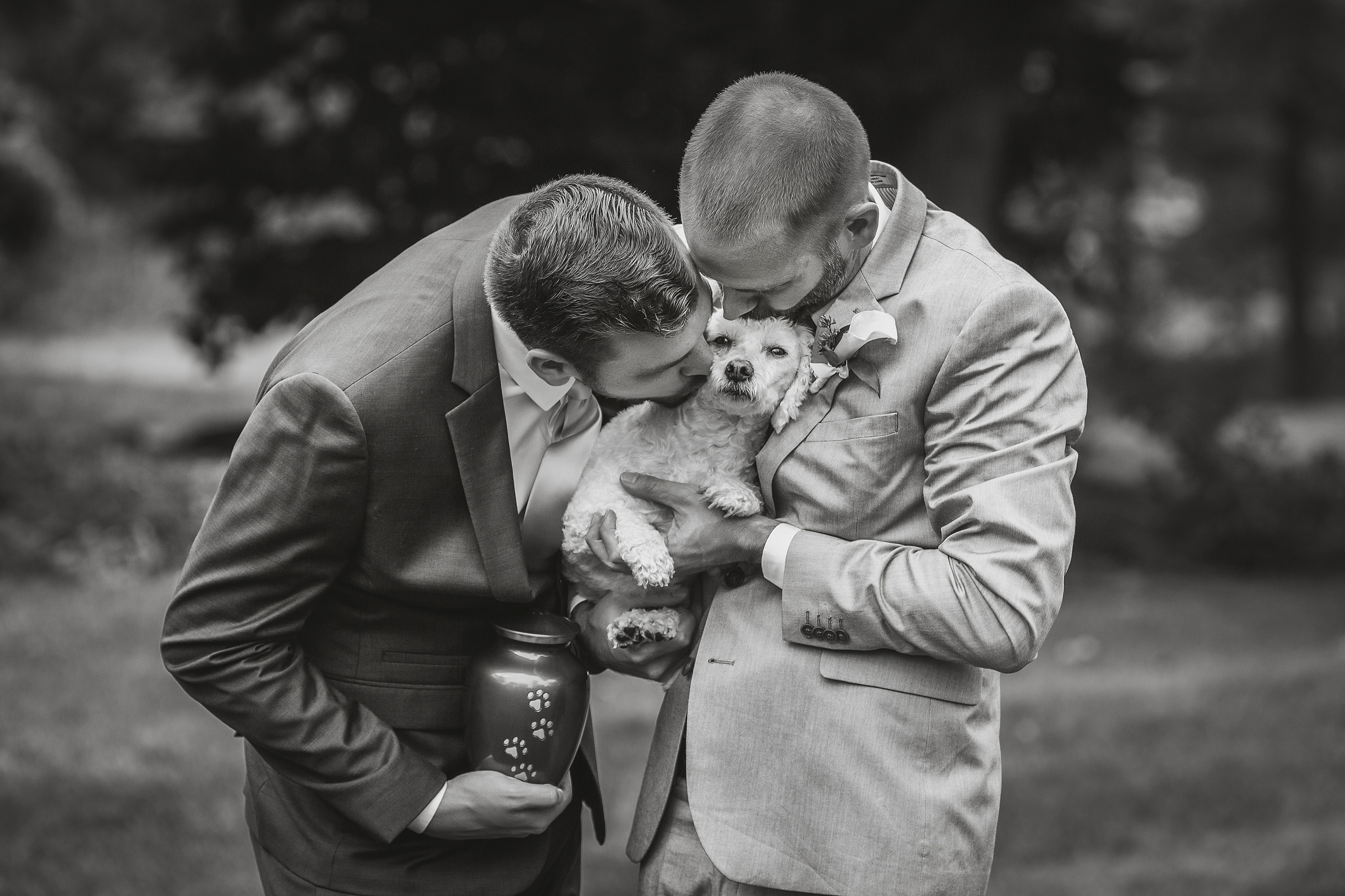 Photo of couple kissing their darling dog by Amber Henry Photography - Detroit, Michigan
