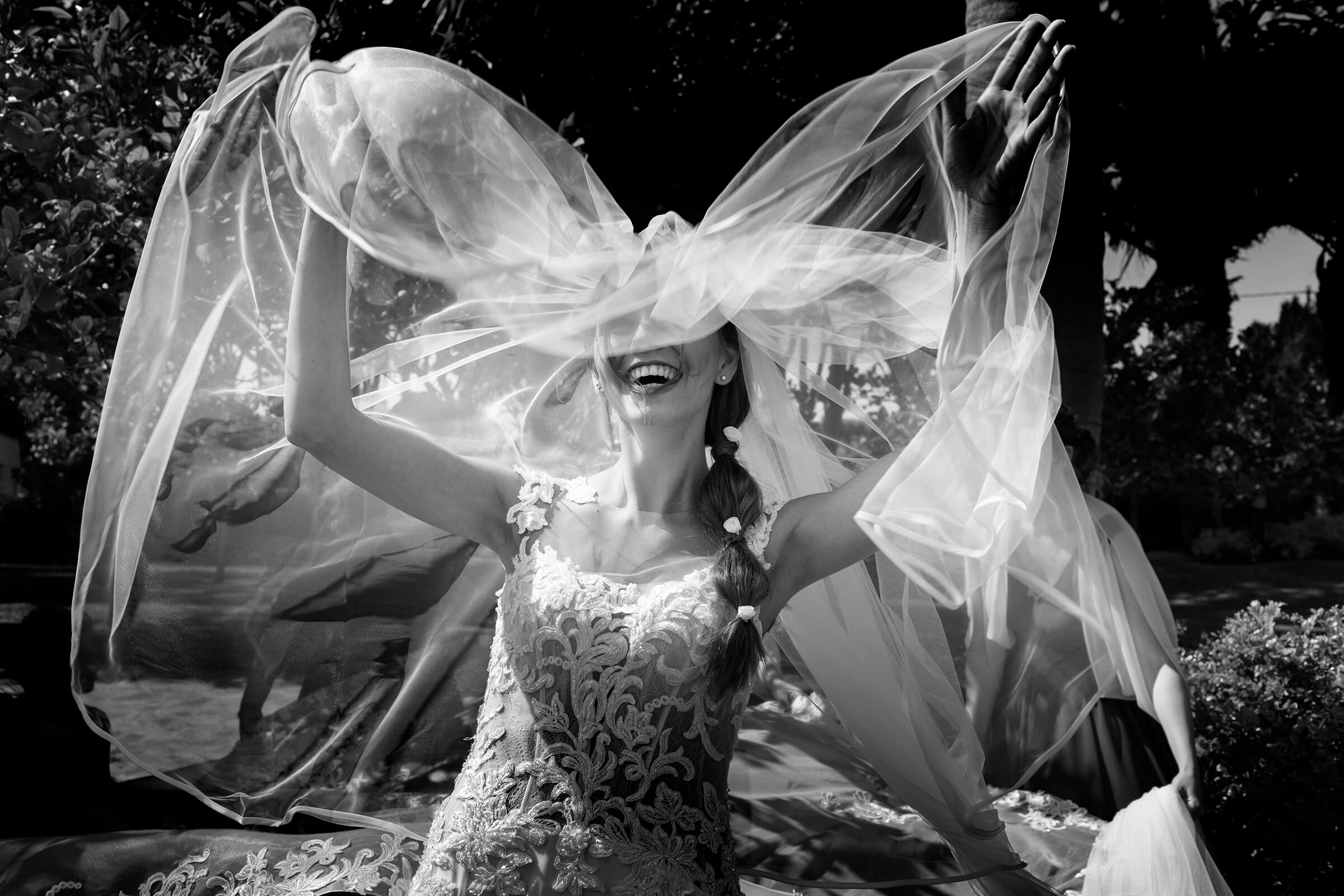 Bride playing butterfly with her veil - photo by Nino Lombardo Photographer