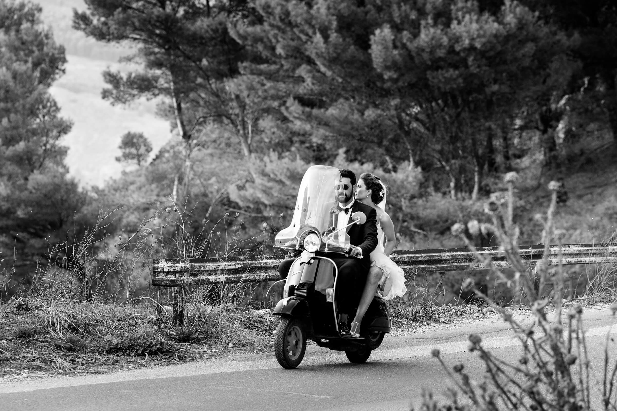 Couple exit on motor scooter - photo by Nino Lombardo Photographer