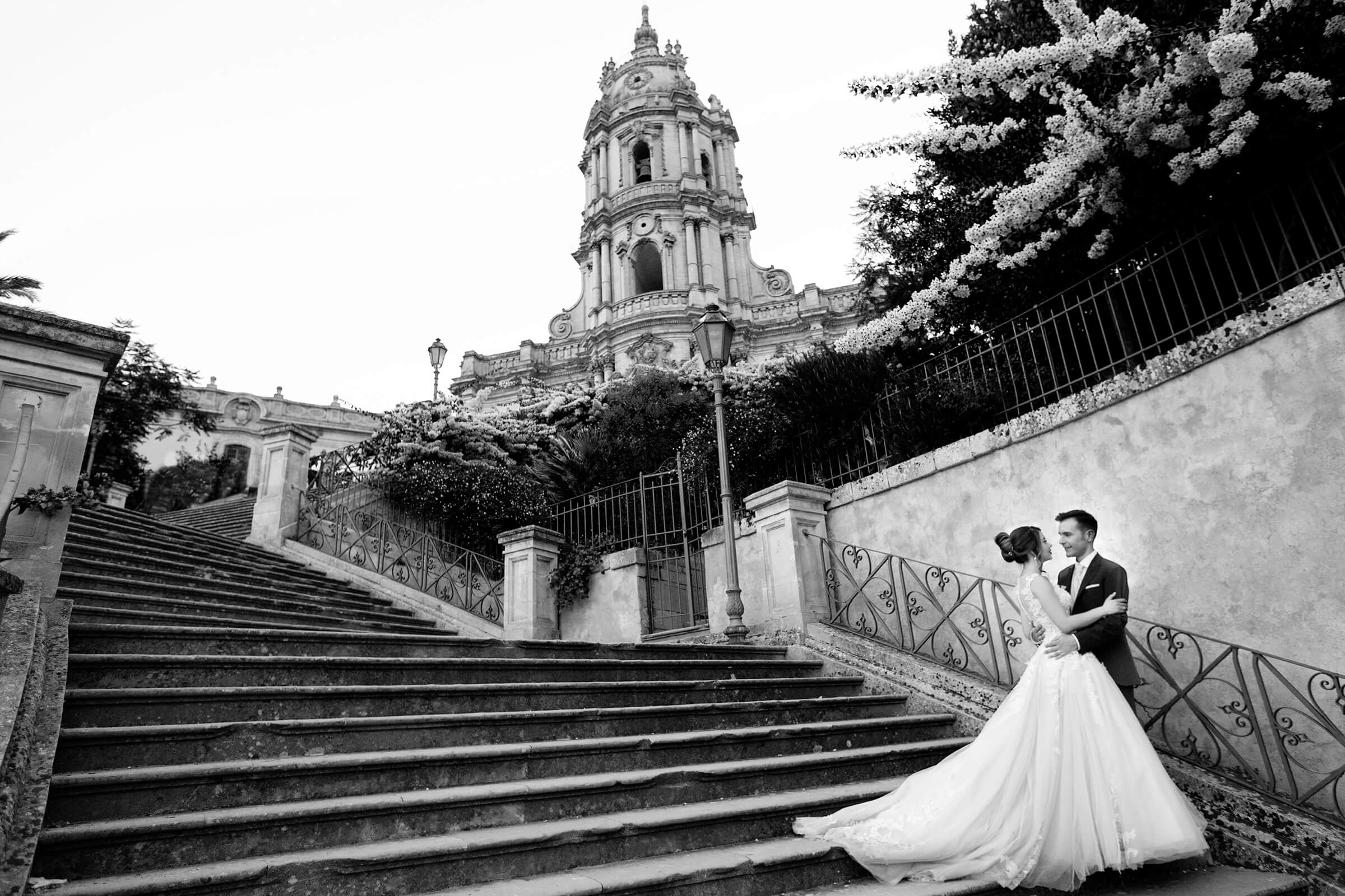 Couple on grand outdoor staircase in Sicily- photo by Nino Lombardo Photographer