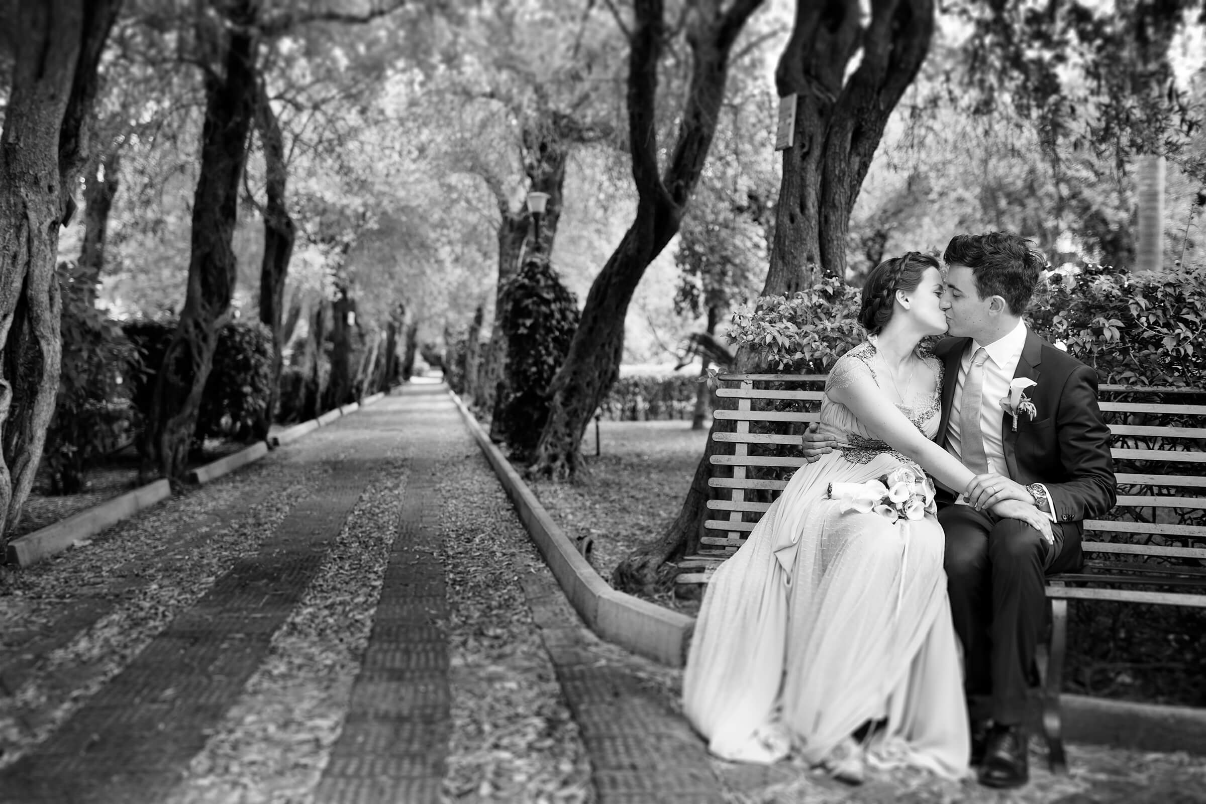 Romantic couple on bench in landscape setting - photo by Nino Lombardo Photographer