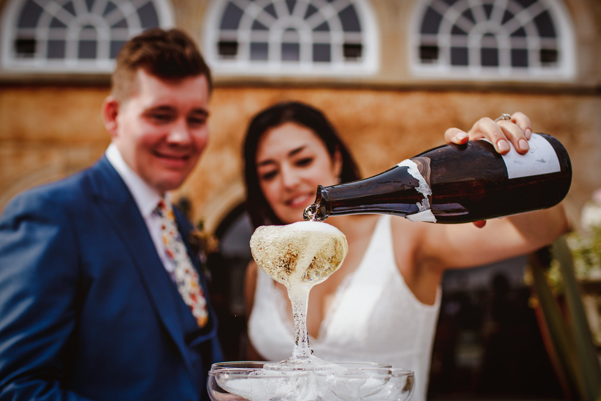 Bride pouring the bubbly - photo by Tomas Juskaitis Photography