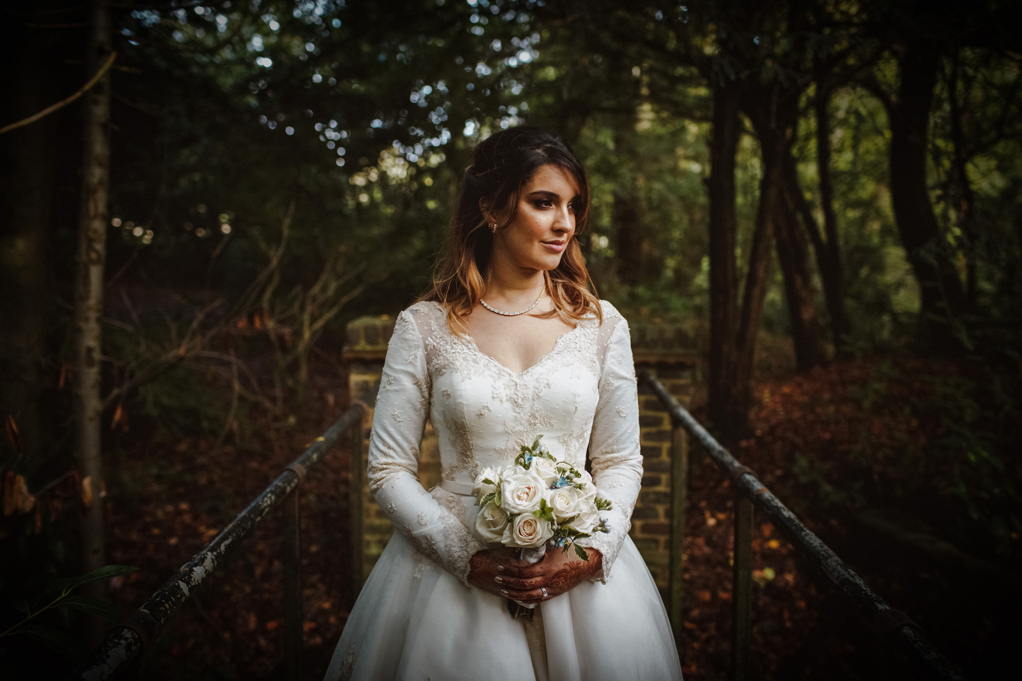 Bride with bouquet in rustic setting - photo by Tomas Juskaitis Photography