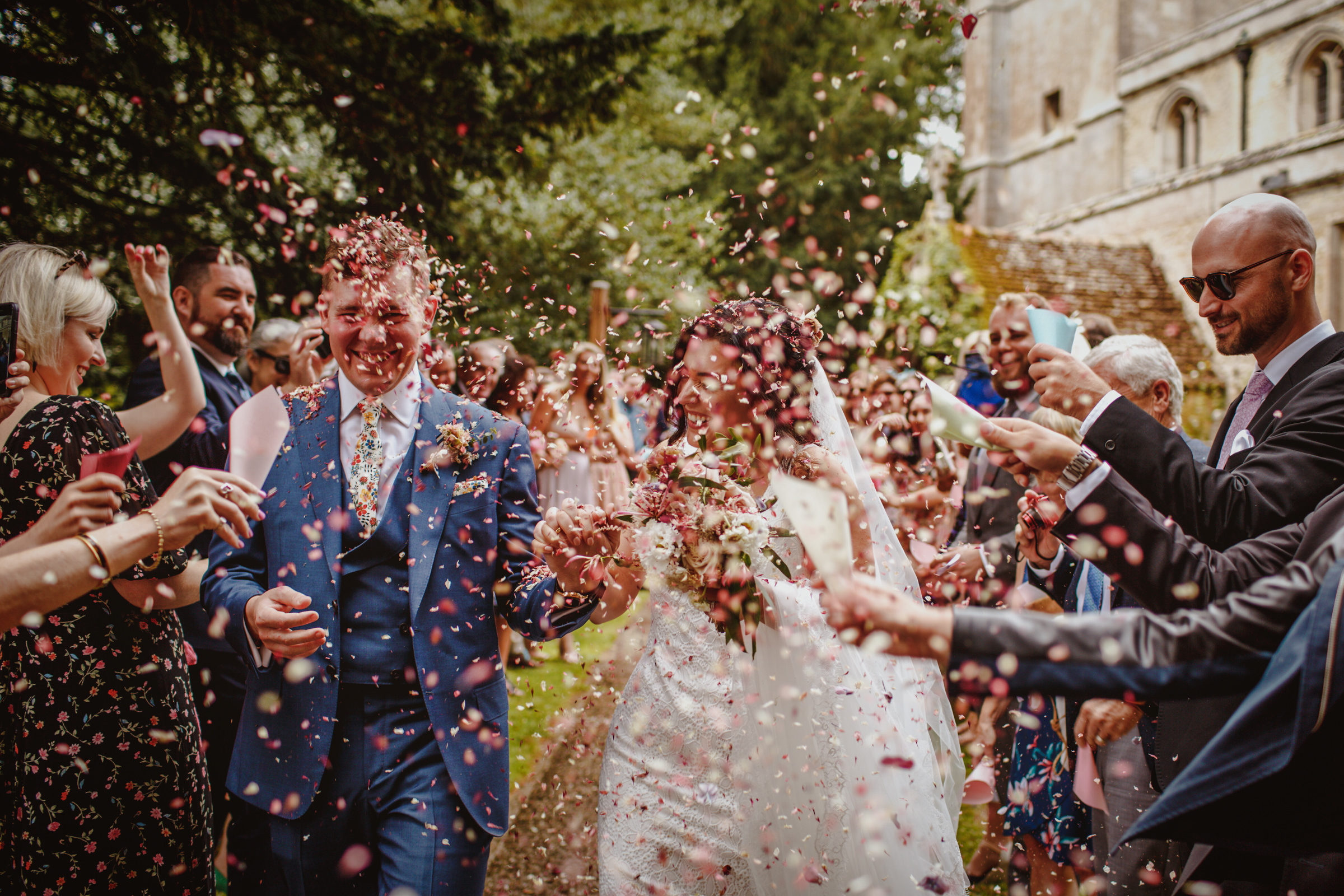 Couple exit under confetti - photo by Tomas Juskaitis Photography