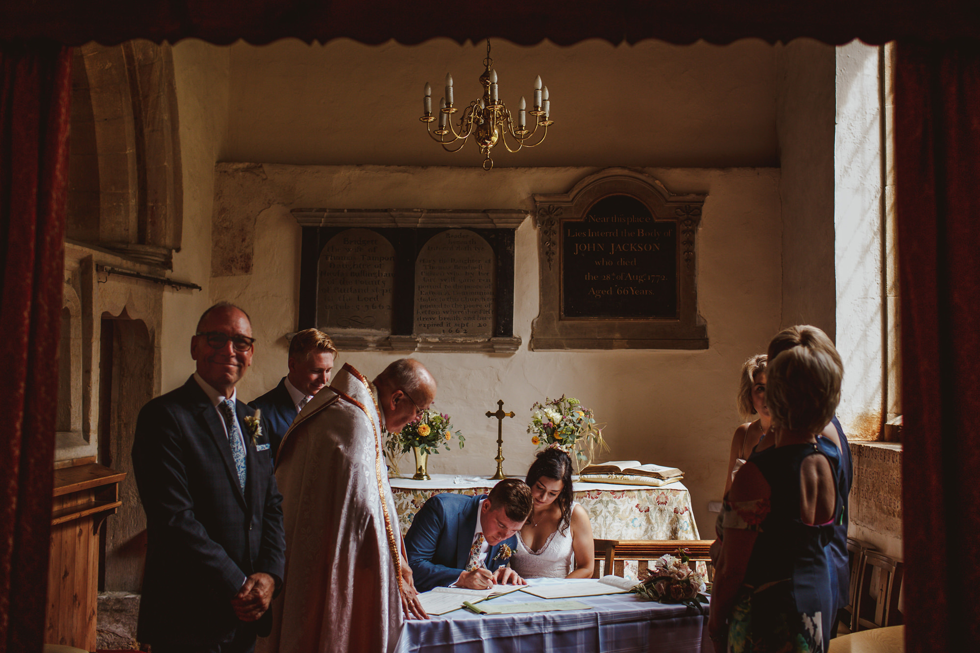 Couple signing church marriage registry - photo by Tomas Juskaitis Photography