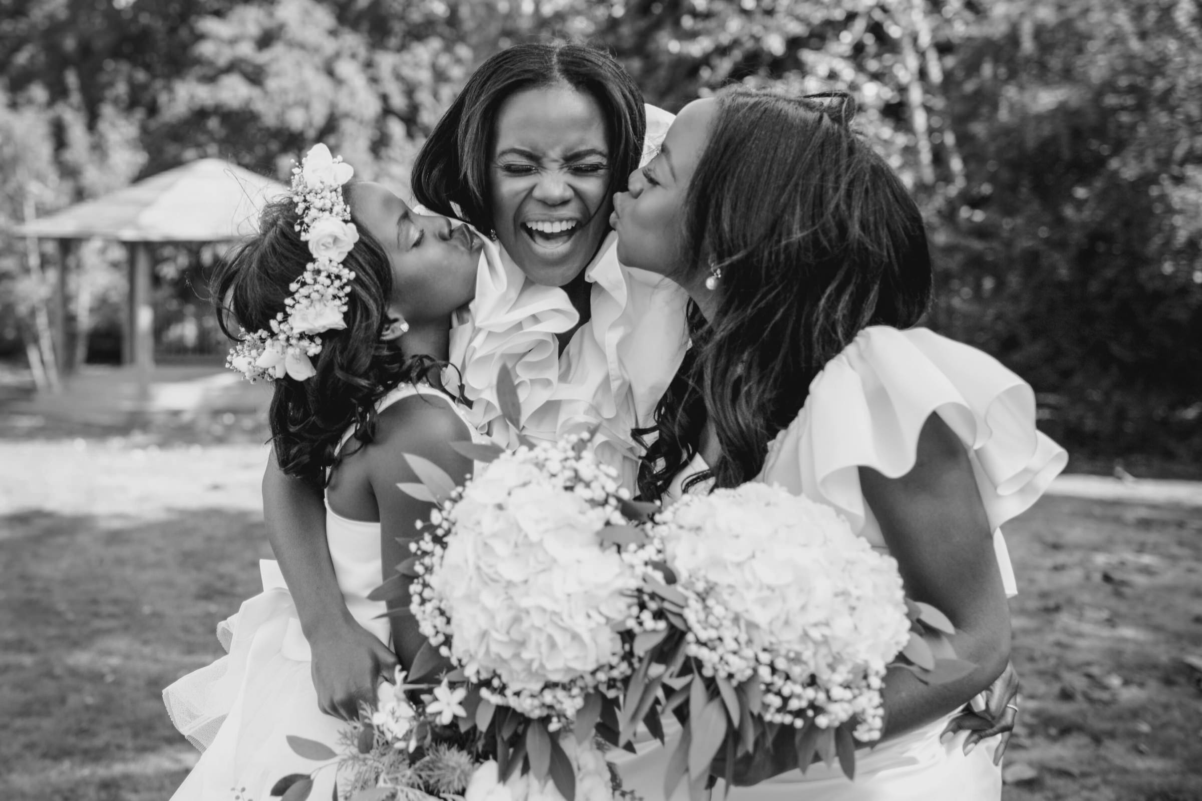 Flower girl smooches for the bride - photo by Tomas Juskaitis Photography