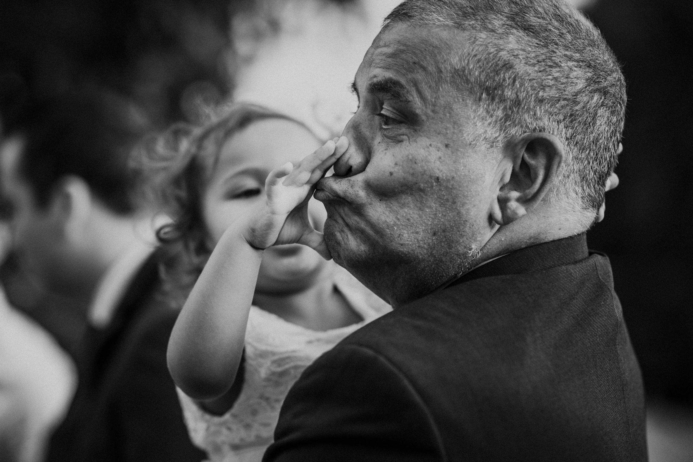 Funny face from man holding little girl - photo by Tomas Juskaitis Photography