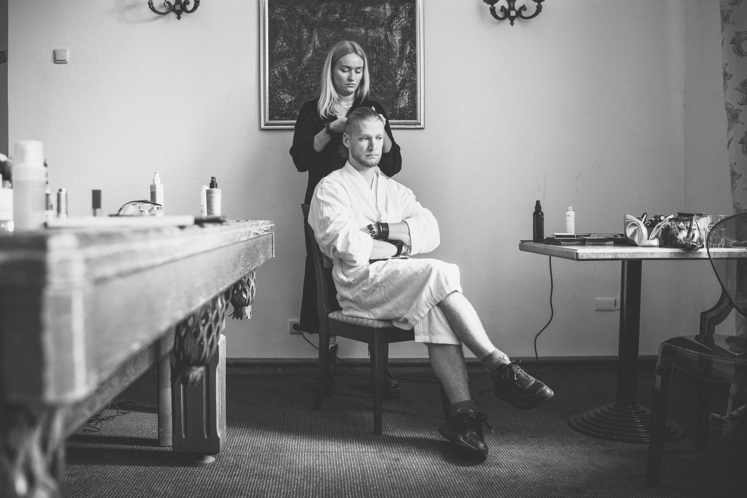 Groom having his hair styled - photo by Tomas Juskaitis Photography