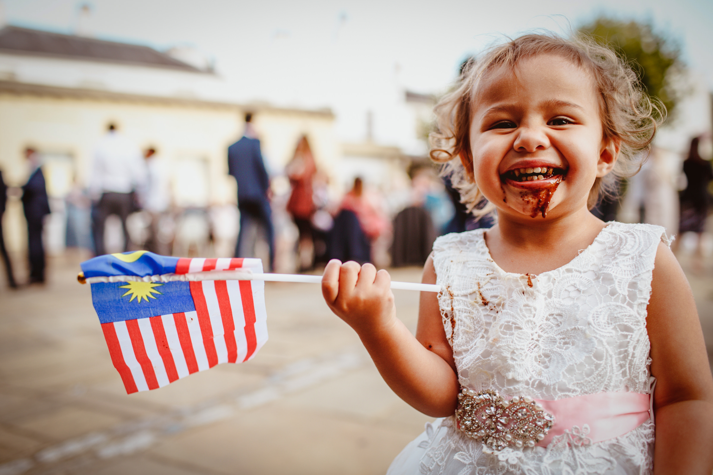 Little girl with Malaysian flag - photo by Tomas Juskaitis Photography