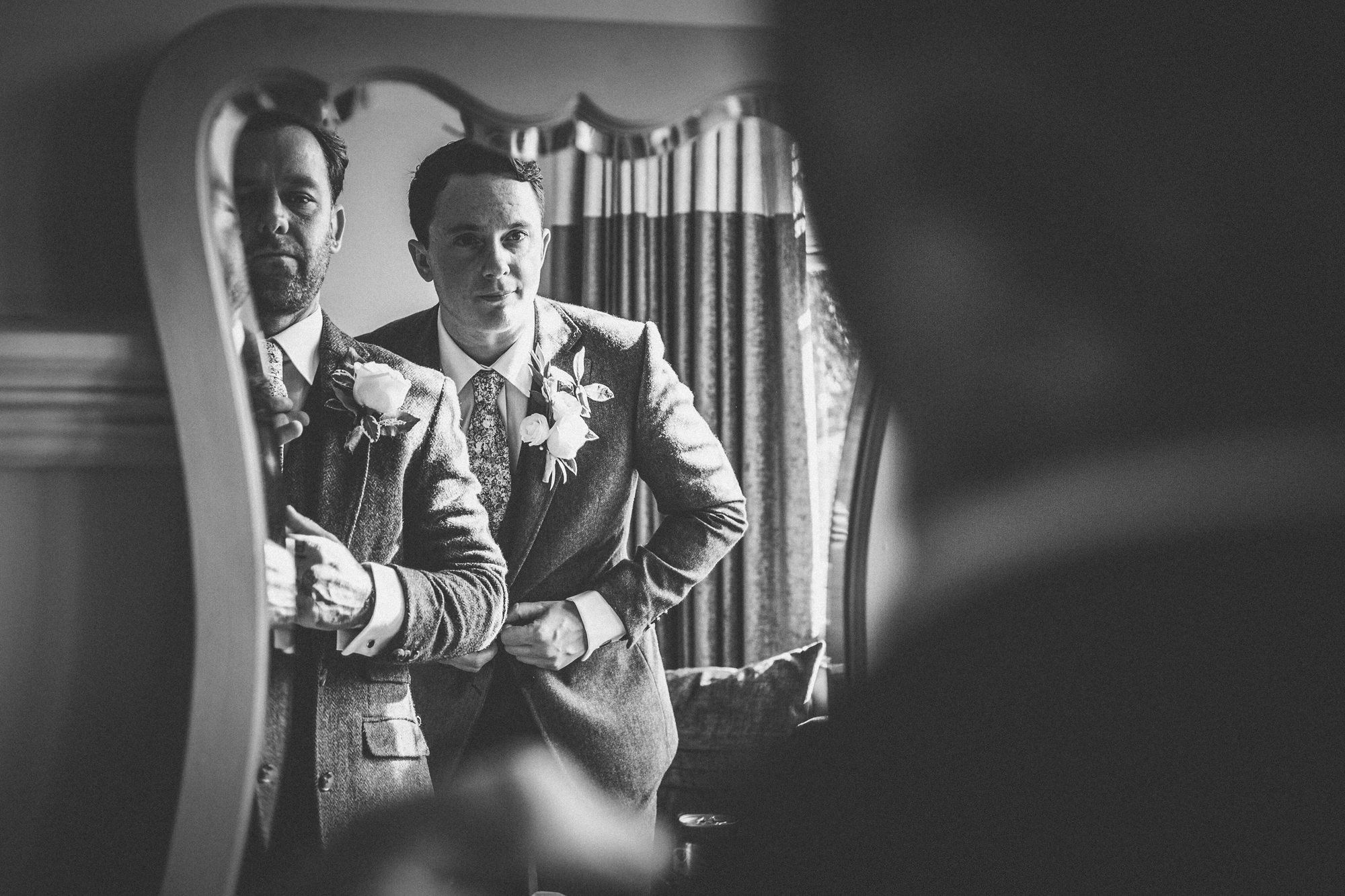Reflected grooms getting ready - photo by Tomas Juskaitis Photography