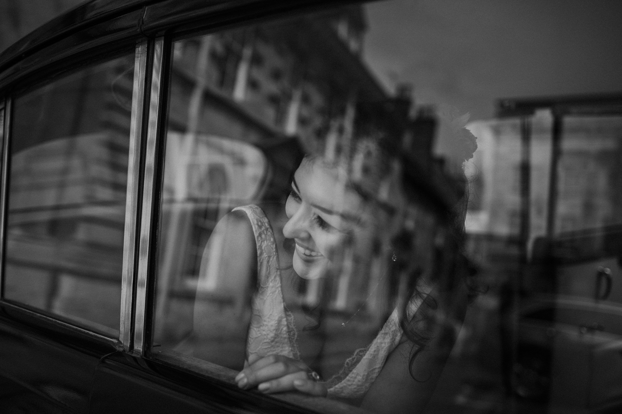 Smiling bride in reflection  - photo by Tomas Juskaitis Photography