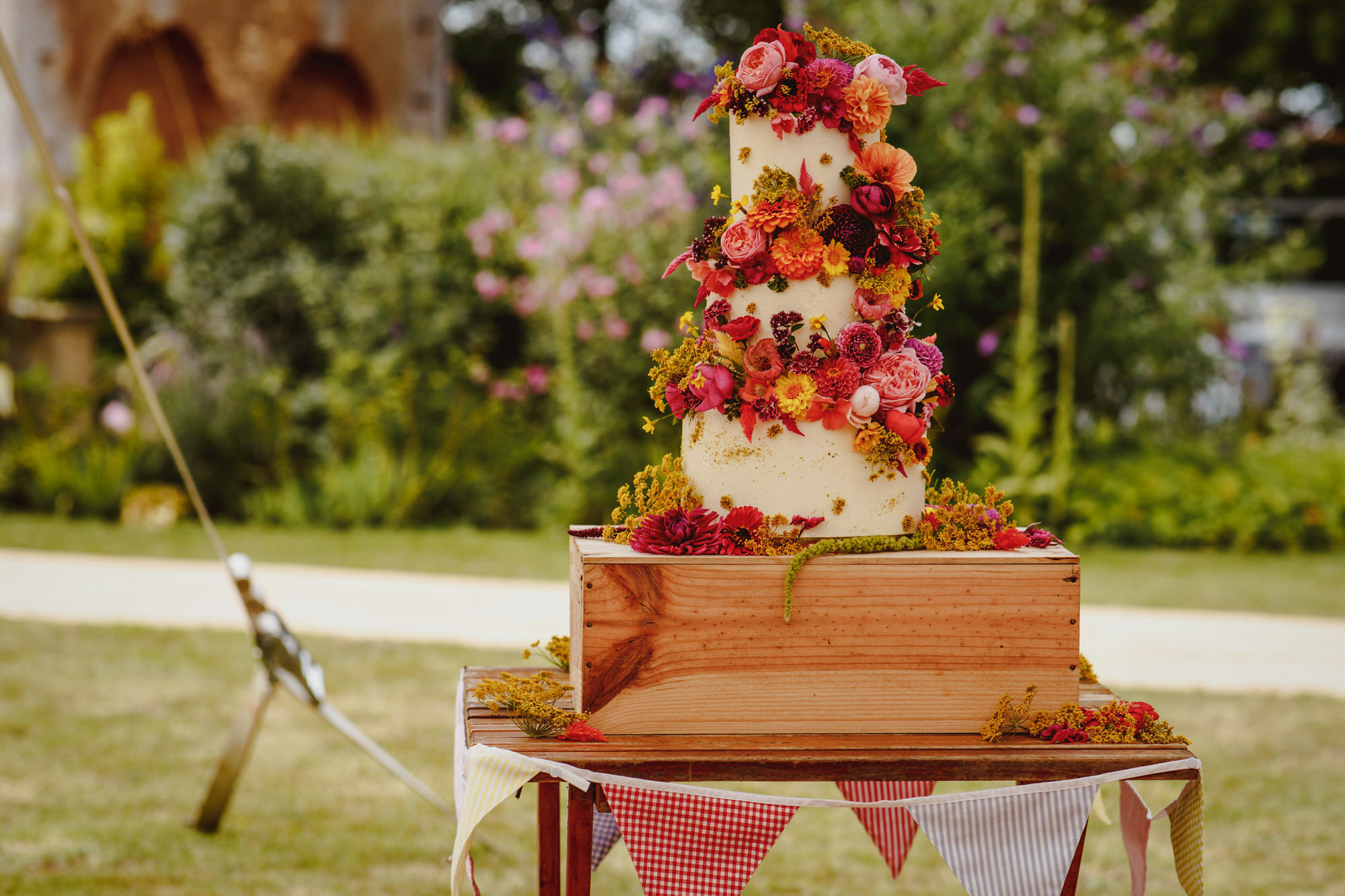 Three tiered cake decorated with floral decorations - photo by Tomas Juskaitis Photography