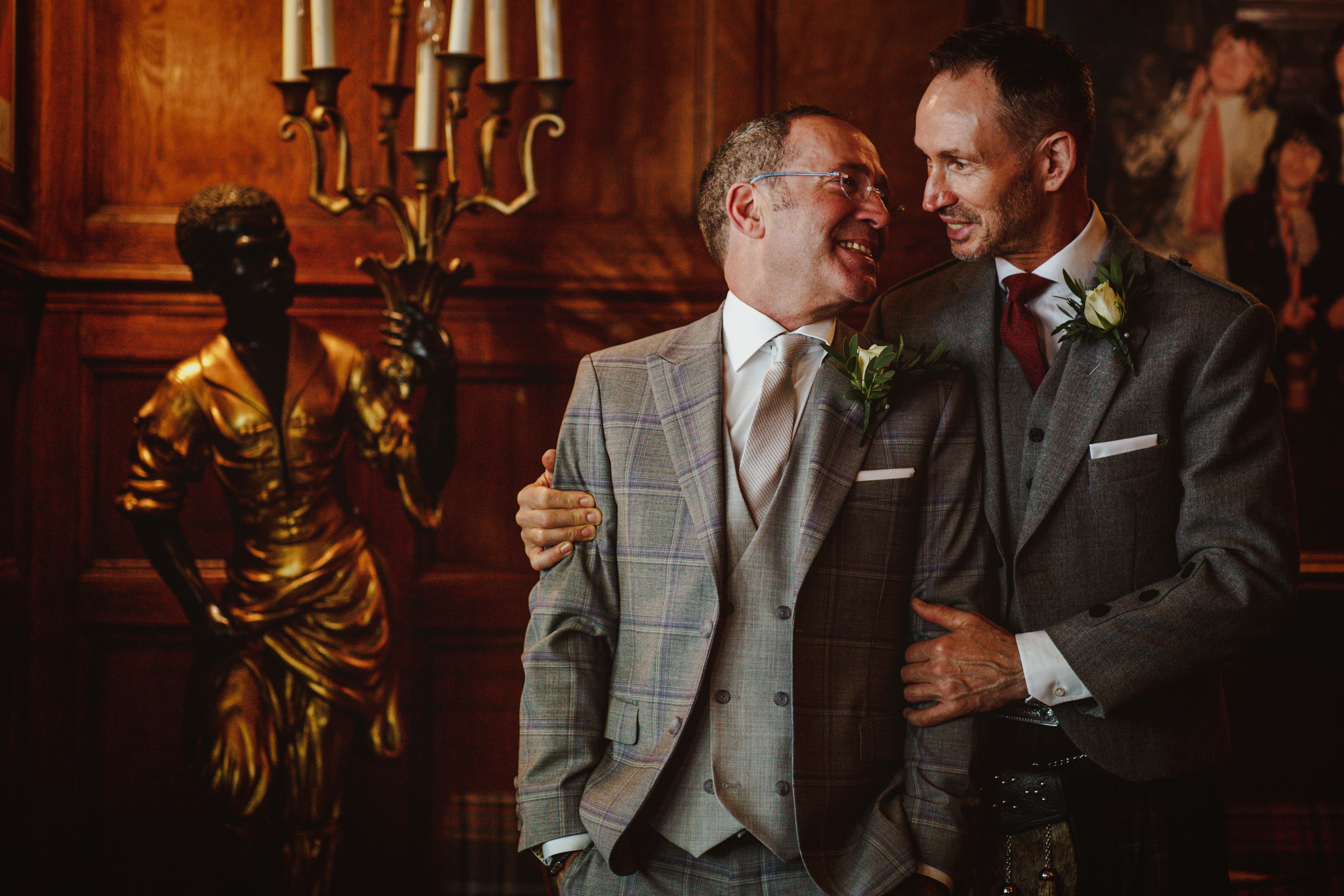 Two grooms embrace - photo by Tomas Juskaitis Photography
