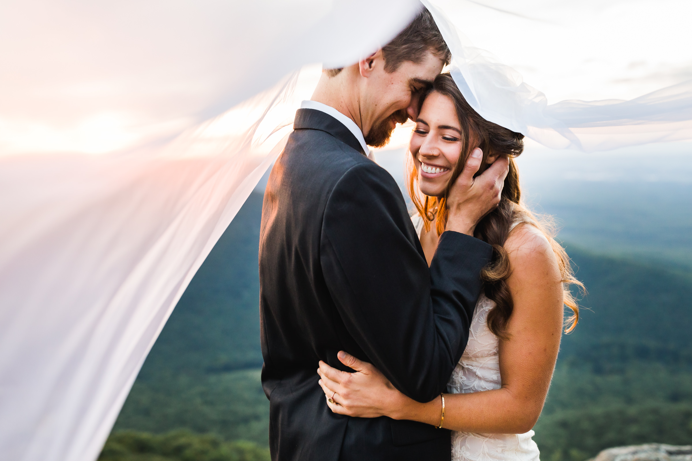 Elopement couple moment under billowing tent - photo by Xiaoqi Li Photography