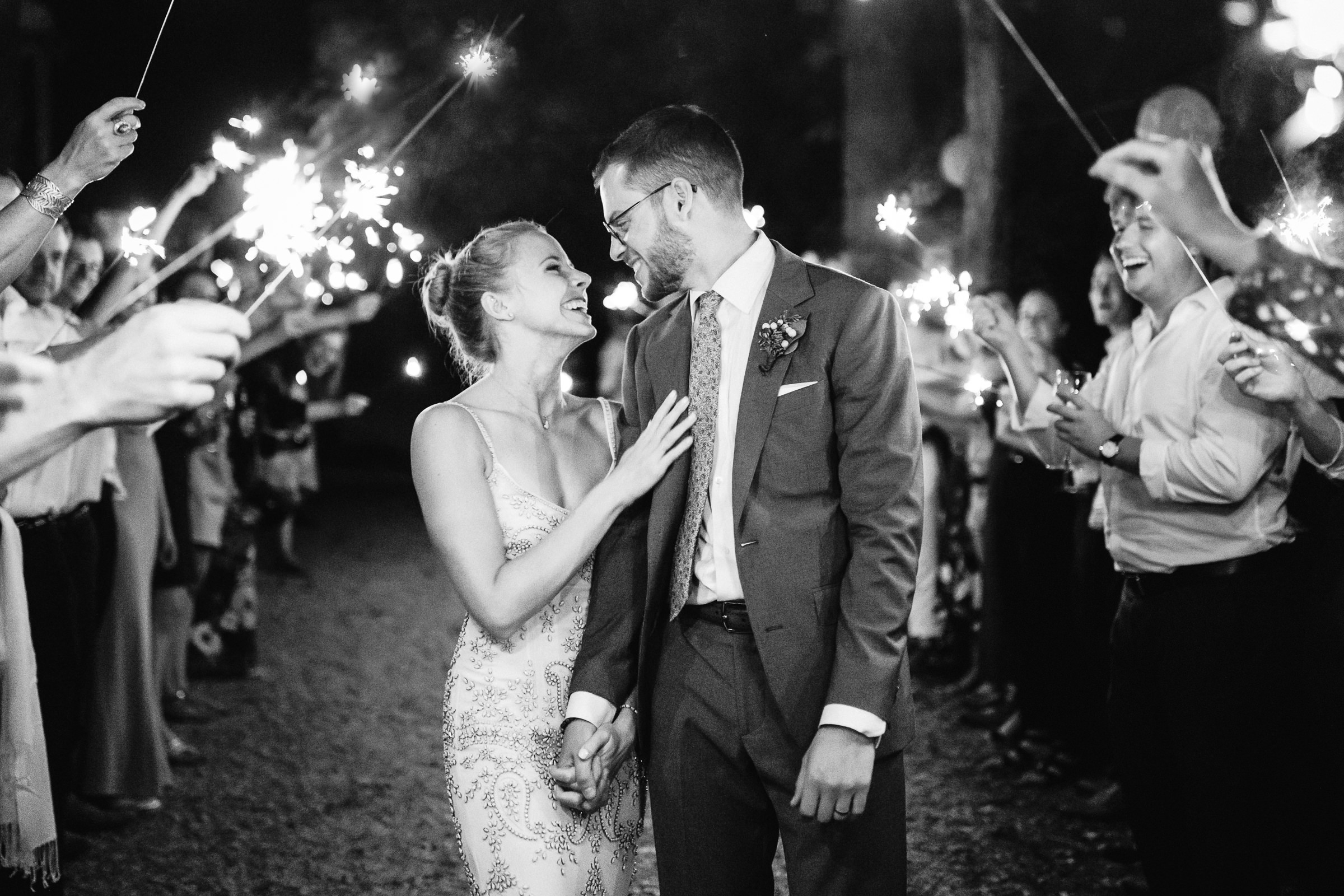 Happy couple moment against sparkler exit - photo by Xiaoqi Li Photography