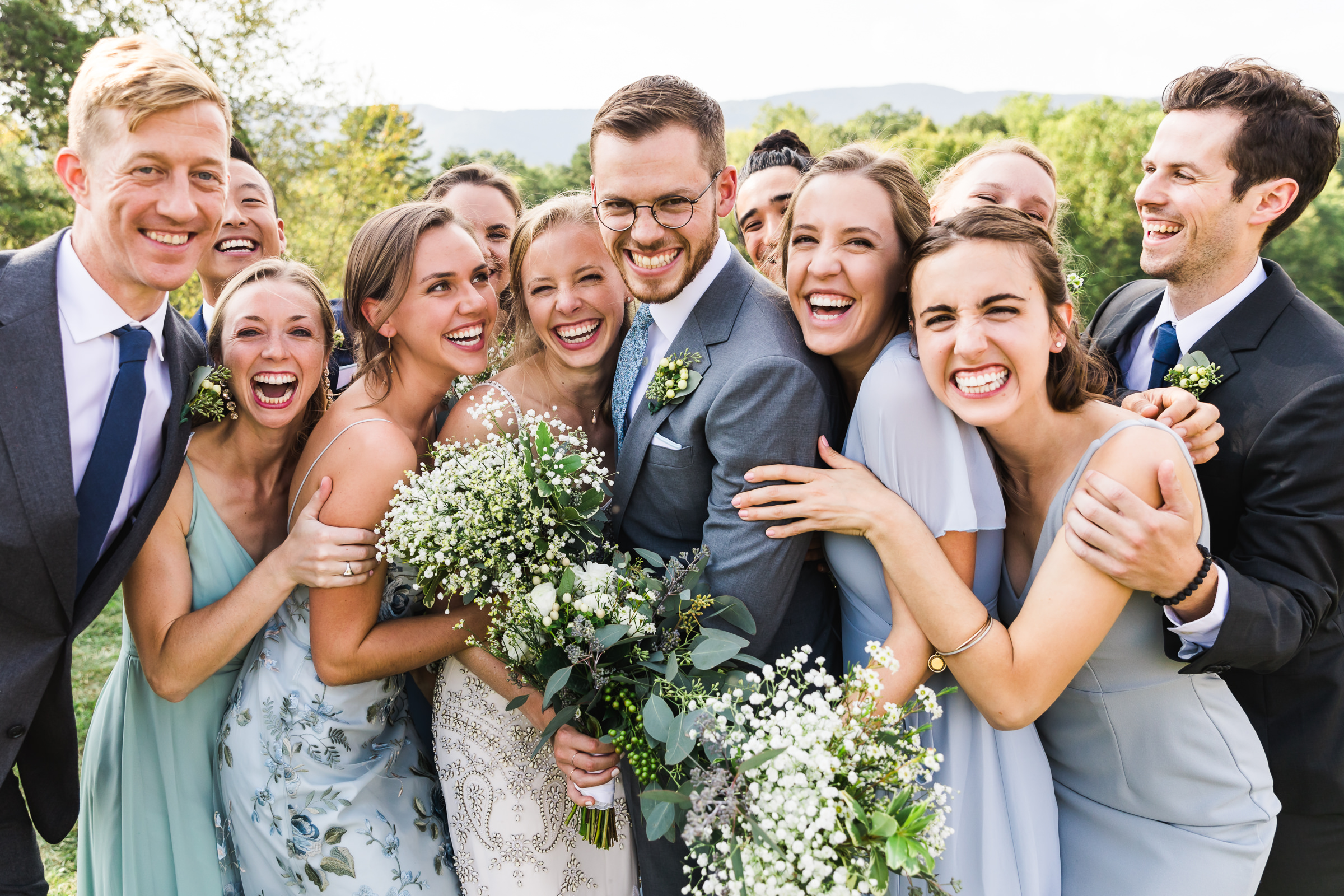 Huge smiles all around with bride and groom - photo by Xiaoqi Li Photography