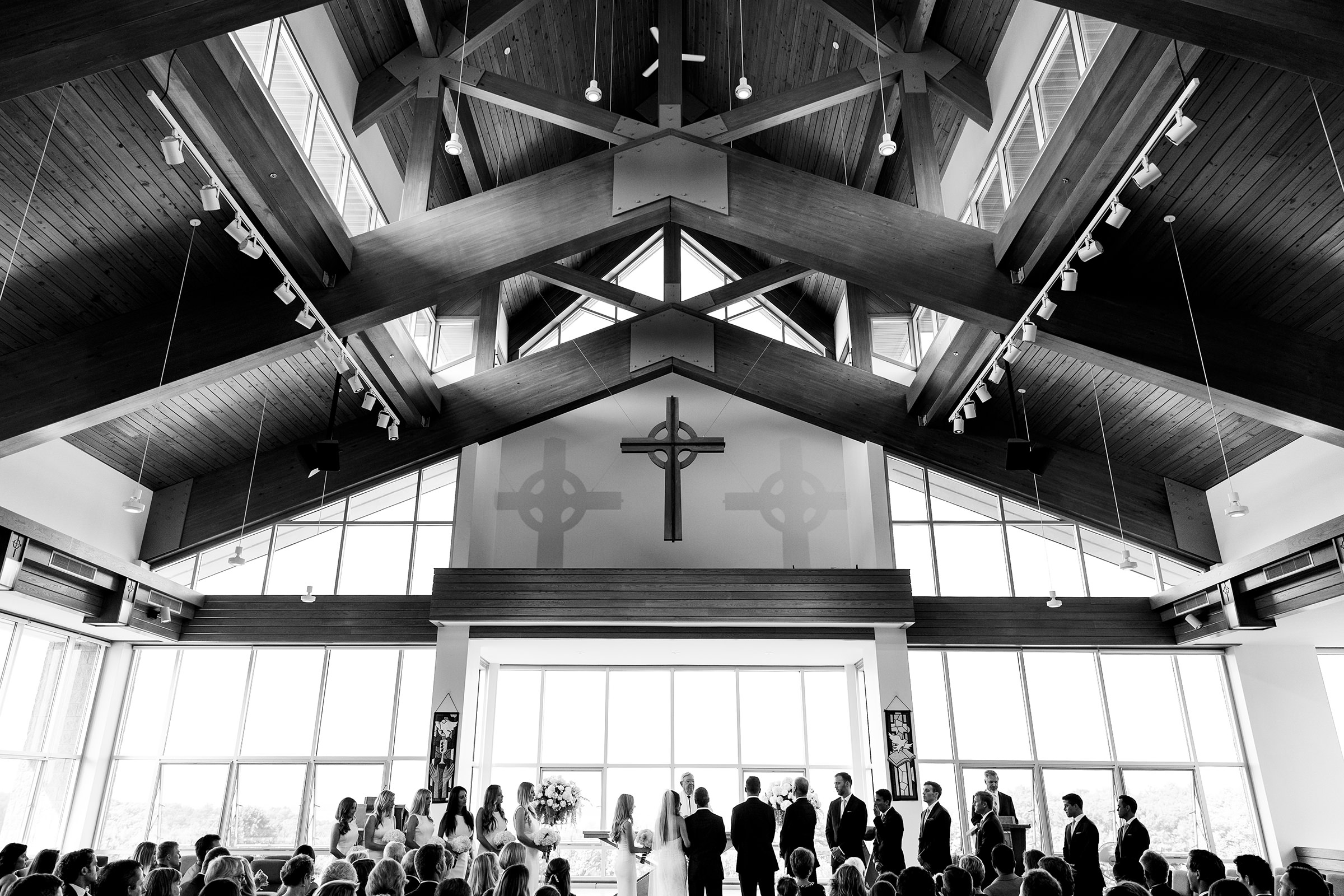 Ceremony in modern wooden church - photo by Rayan Anastor Photography