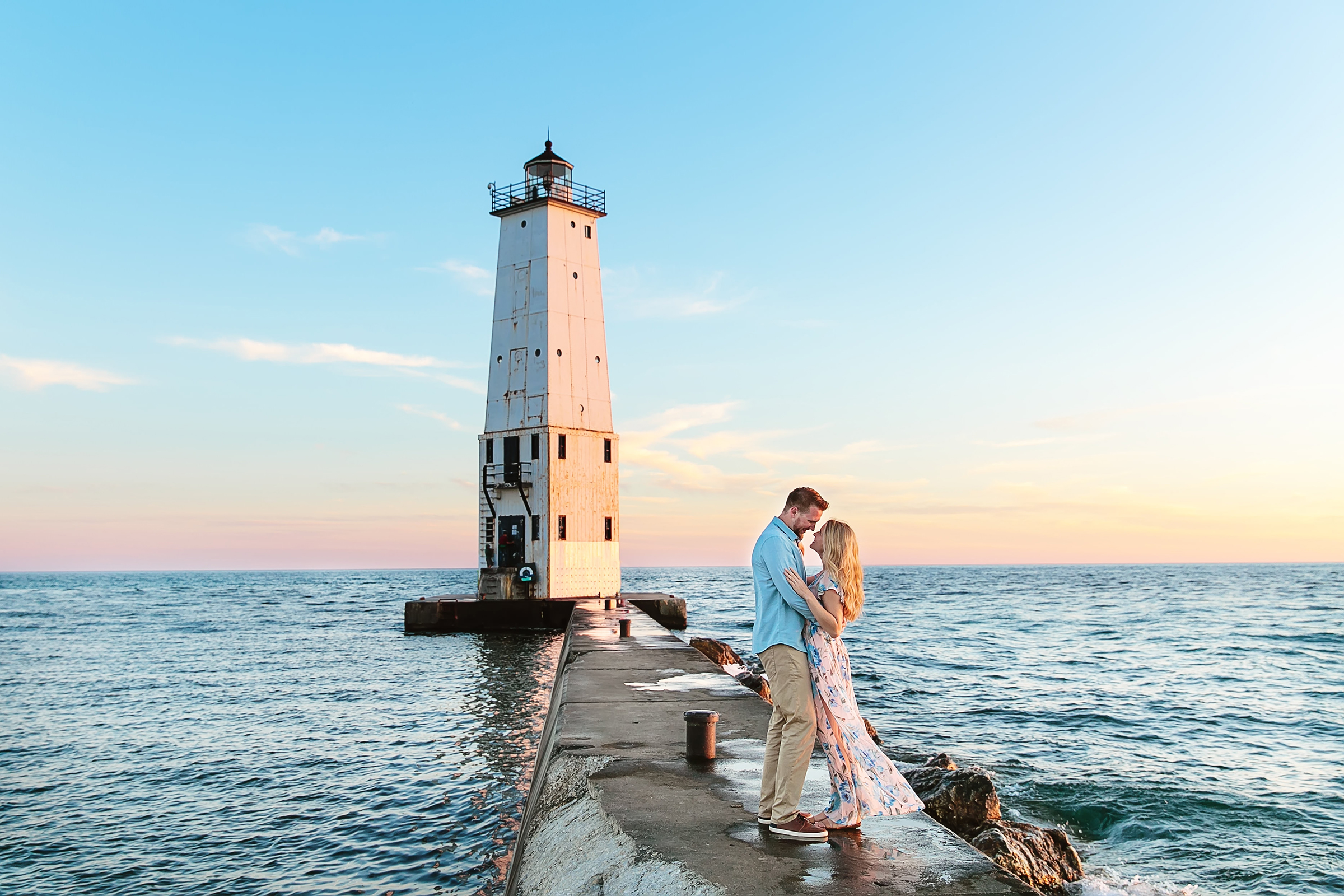 Engagement couple against lighthouse - photo by Rayan Anastor Photography