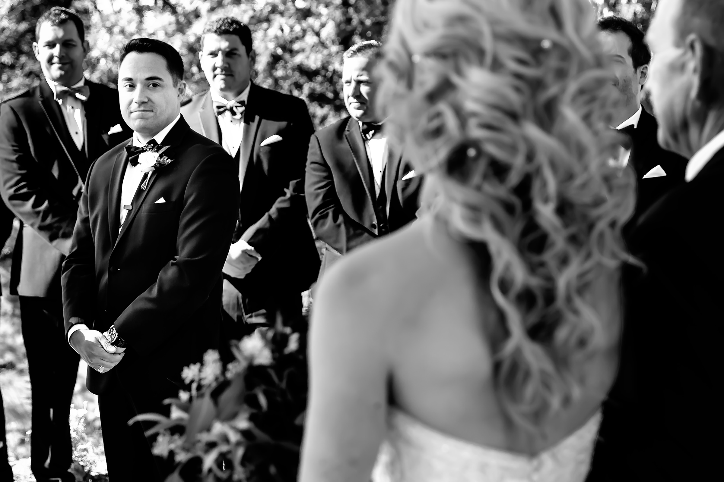 Groom awaits bride with groomsmen - photo by Rayan Anastor Photography