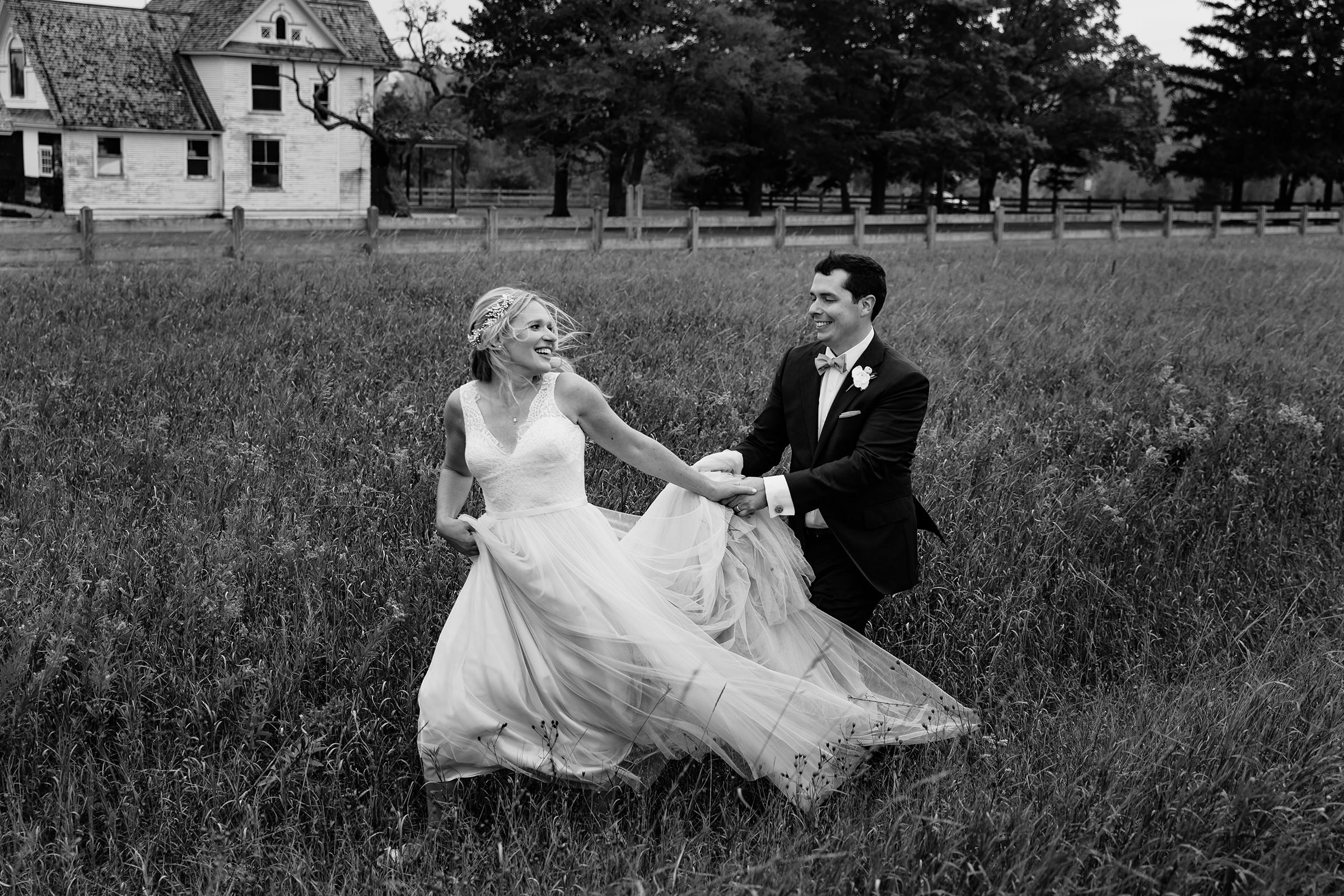 Groom catching running bride in field - photo by Rayan Anastor Photography