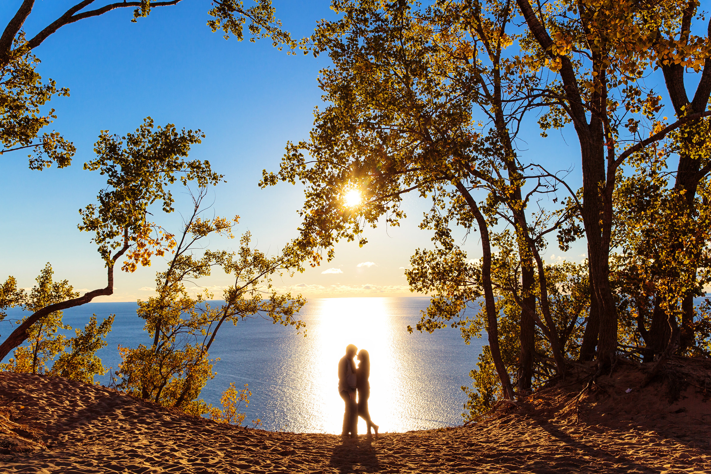 Silhouette engagement couple at Sleeping Bear Dunes - photo by Rayan Anastor Photography