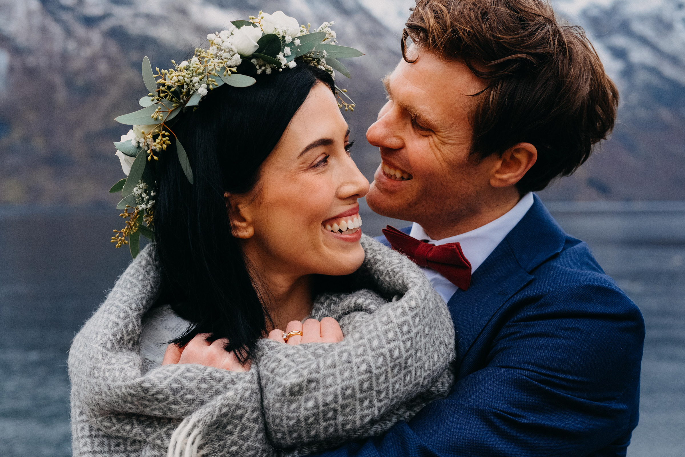 Cozy couple portrait against mountain and fjord - photo by Christin Eide Photography