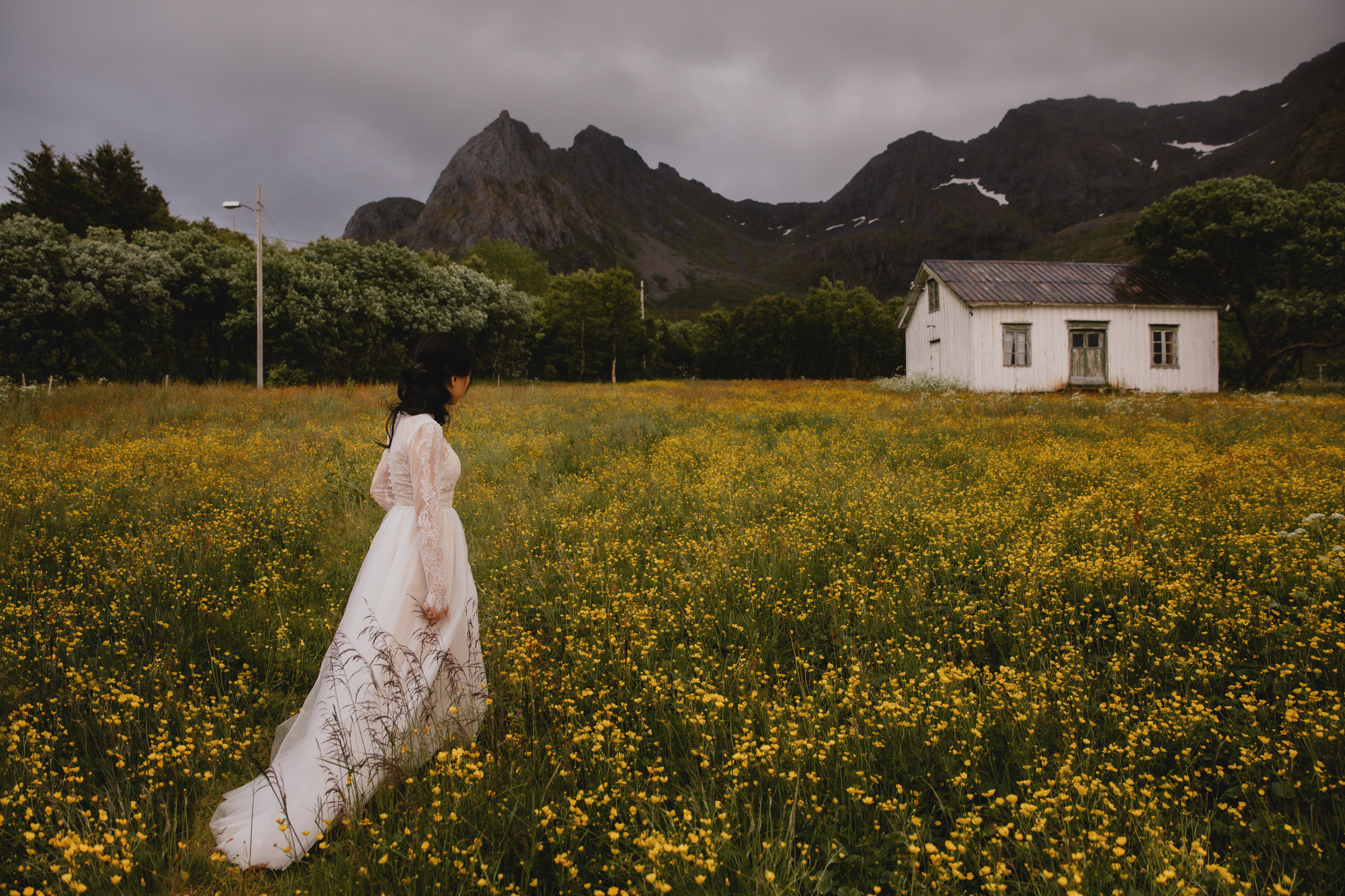 Elopement bride in field of yellow flowers- photo by Christin Eide Photography