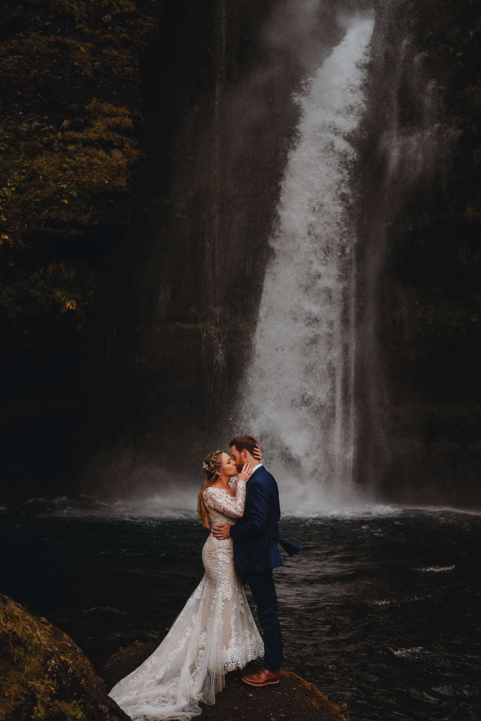 Couple at Iceland waterfall - photo by Christin Eide Photography