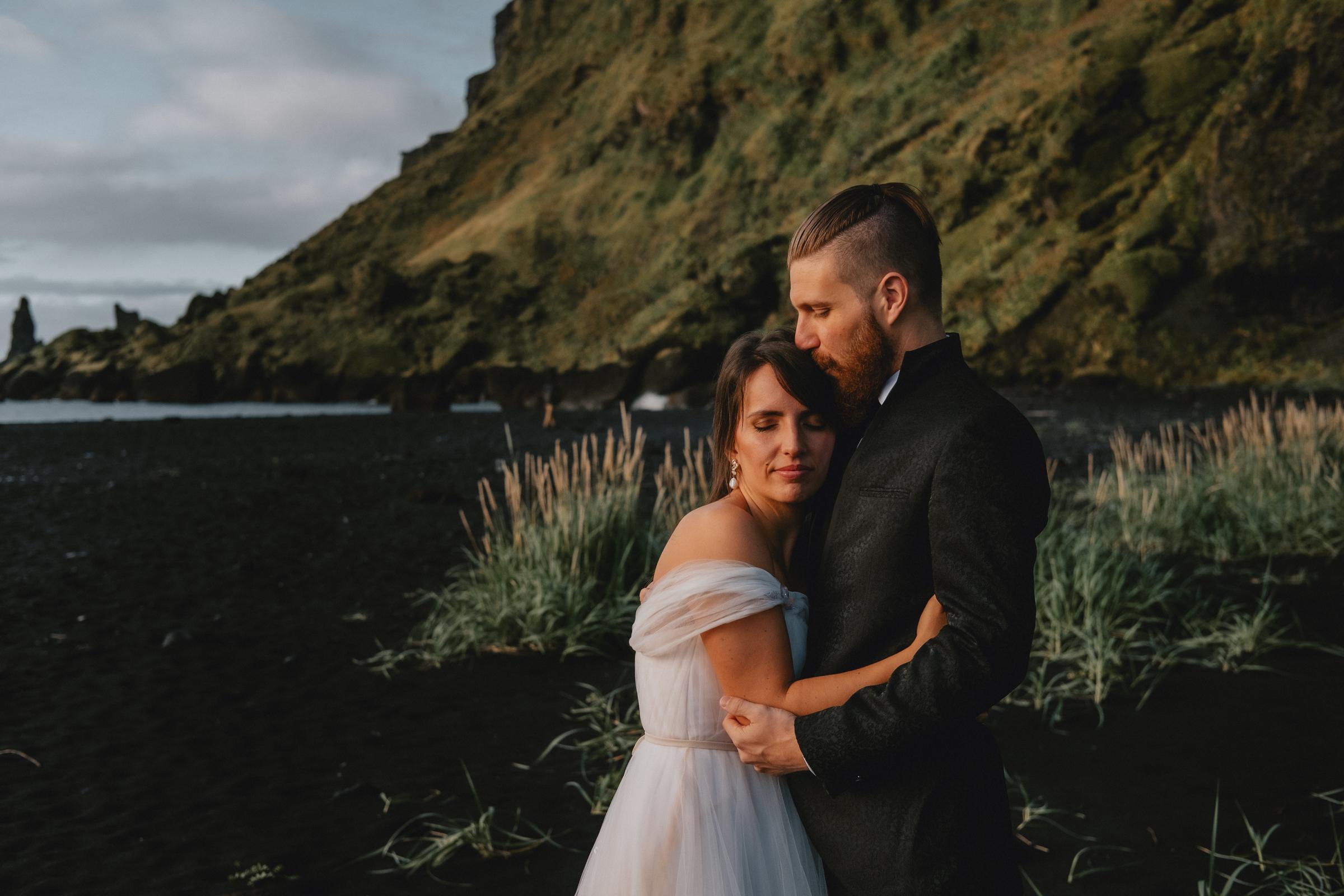 Couple embrace at Iceland sunrise - photo by Christin Eide Photography