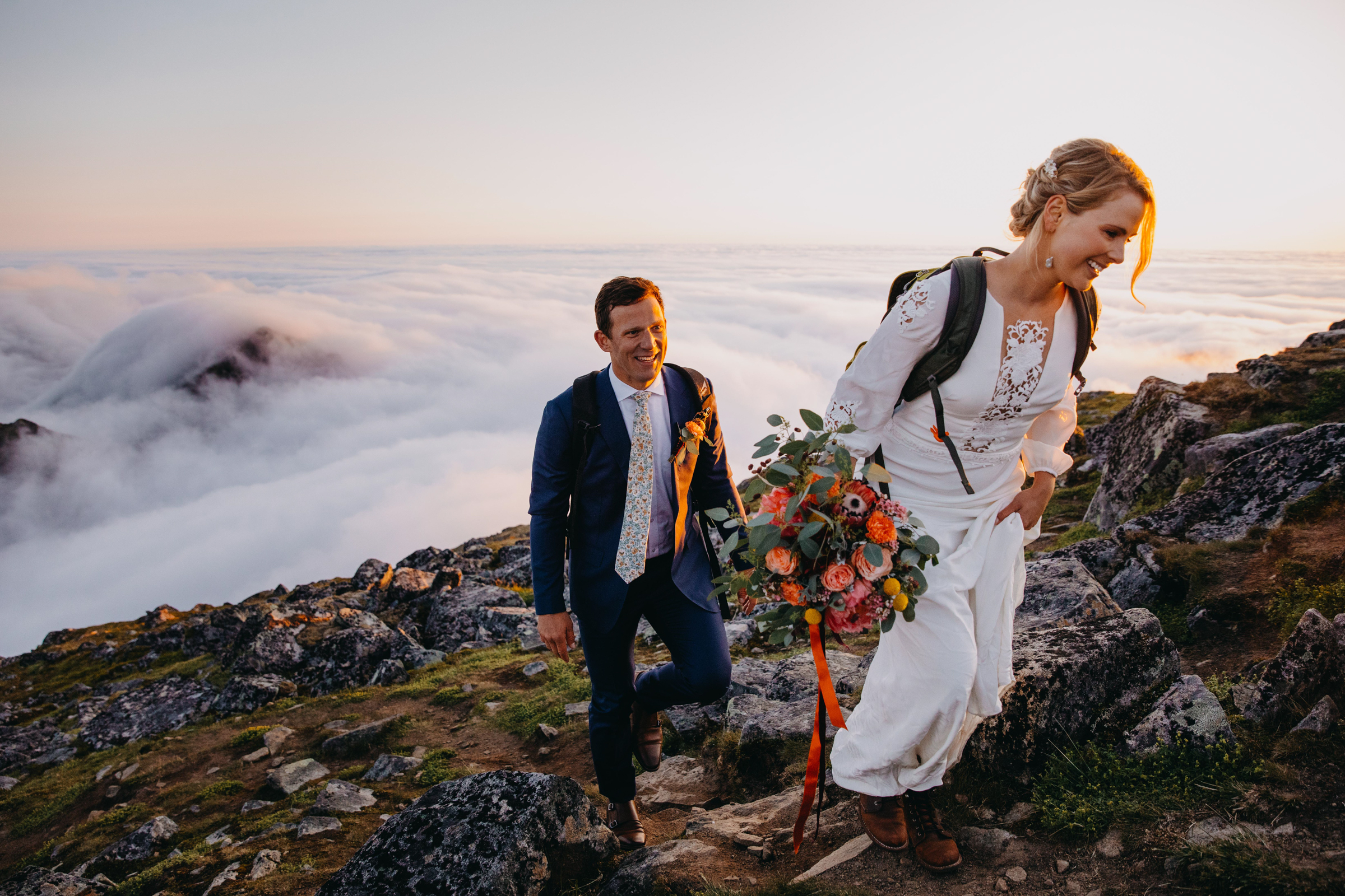 Couple on rocky trail above the clouds - photo by Christin Eide Photography