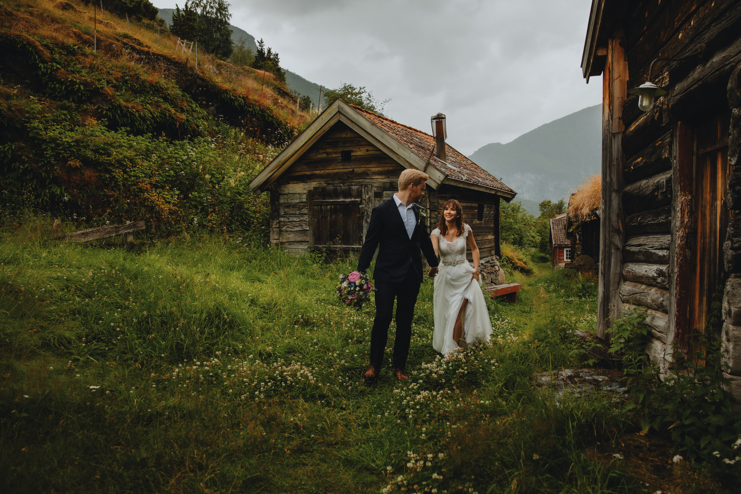Elopement couple among rustic cabins in Aurland Norway - photo by Christin Eide Photography