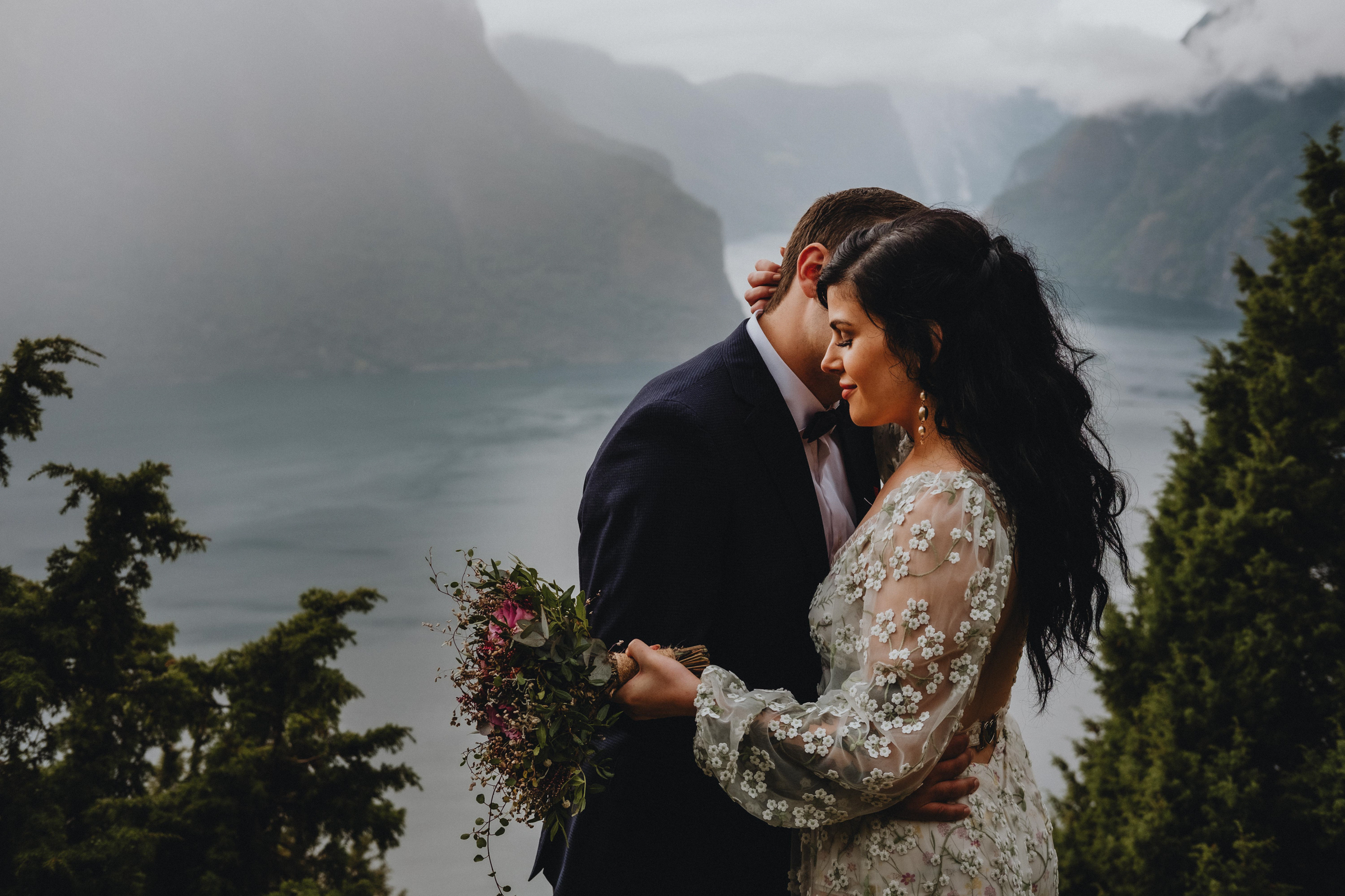 Elopement couple embrace against epic backdrop in Aurland Norway - photo by Christin Eide Photography