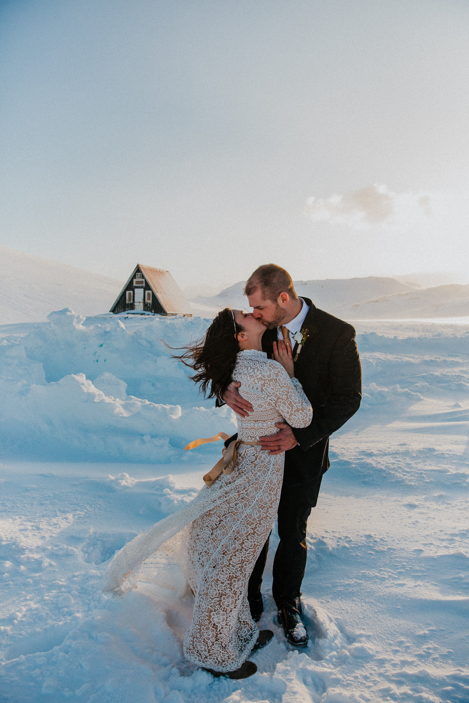 Elopement couple kiss in Iceland blizzard - photo by Christin Eide Photography