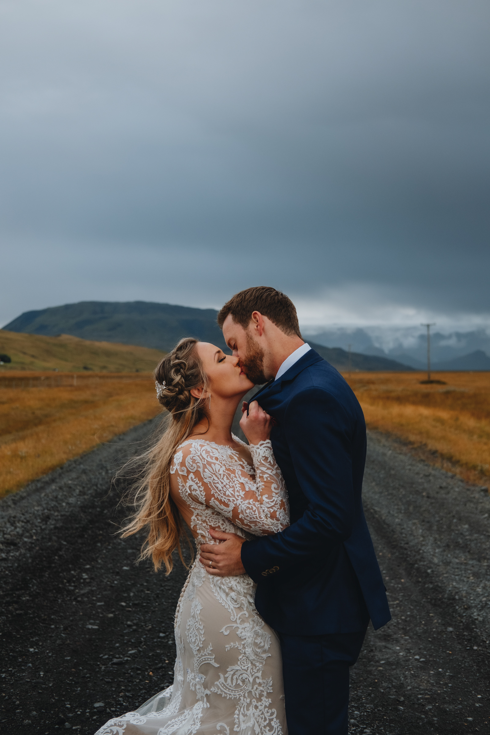Elopement couple kiss on road to nowhere - photo by Christin Eide Photography