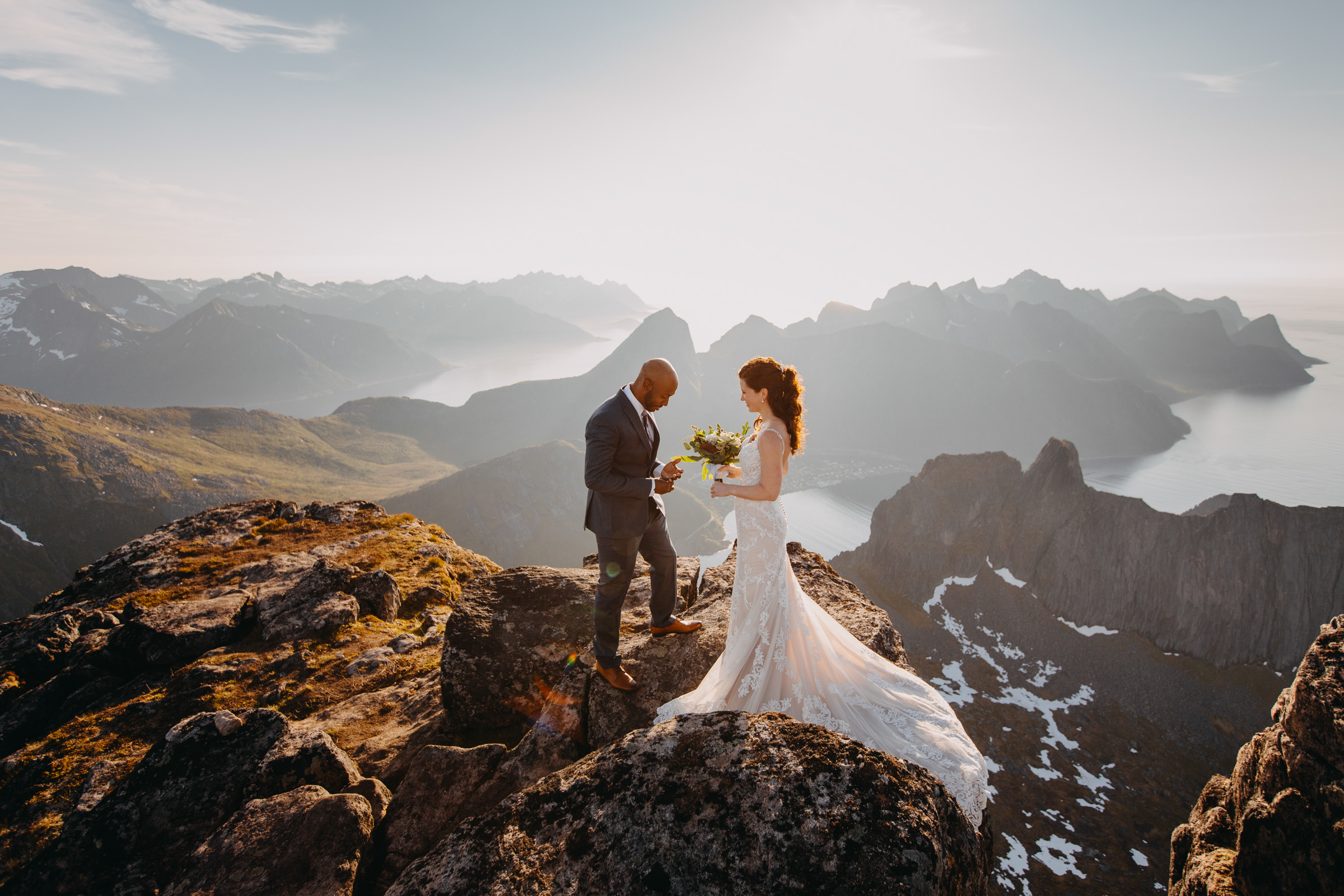 Epic mountain and sea landscape in Senja Norway with elopement couple - photo by Christin Eide Photography