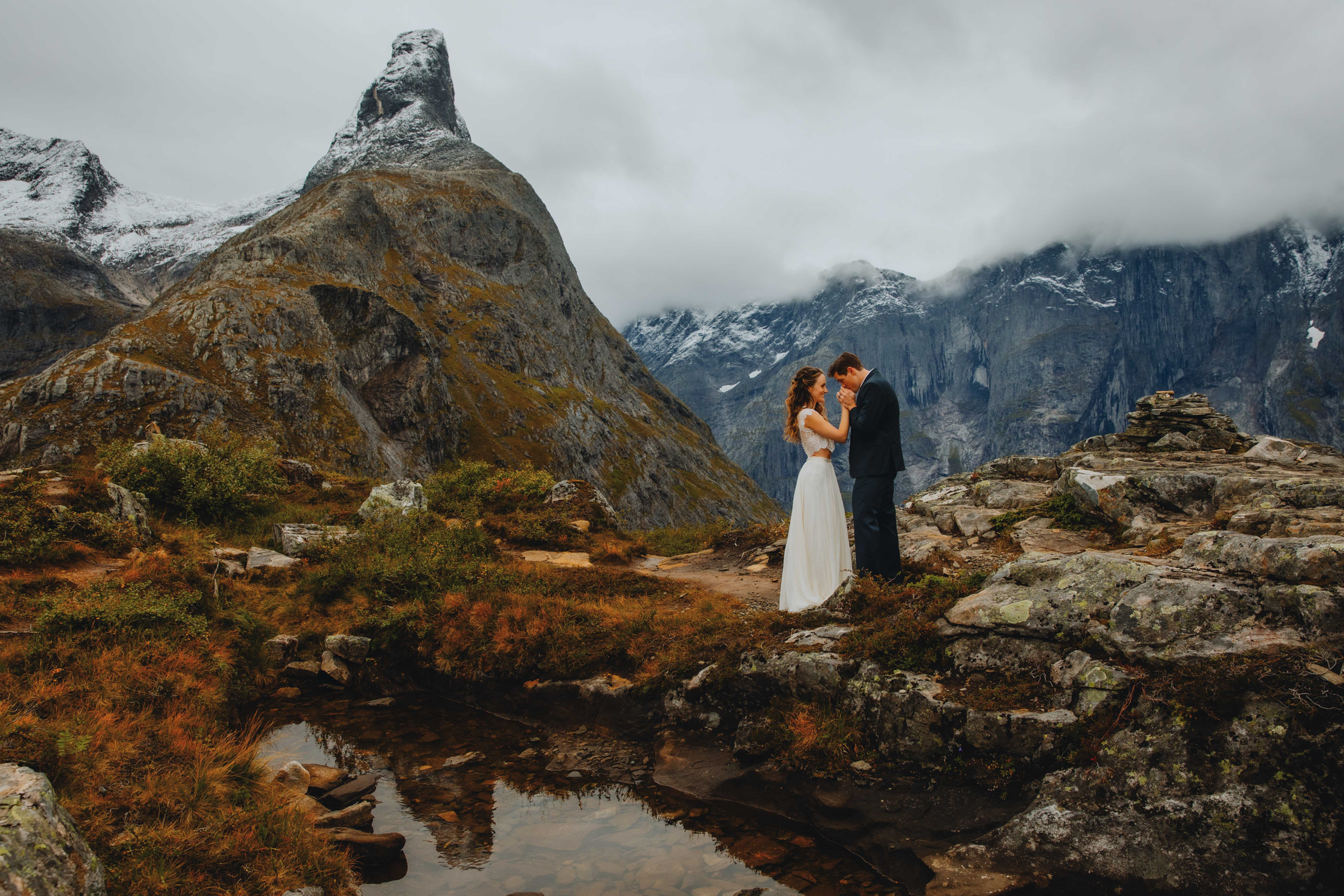 Face to face couple portrait in Norway mountains at Rauma - photo by Christin Eide Photography