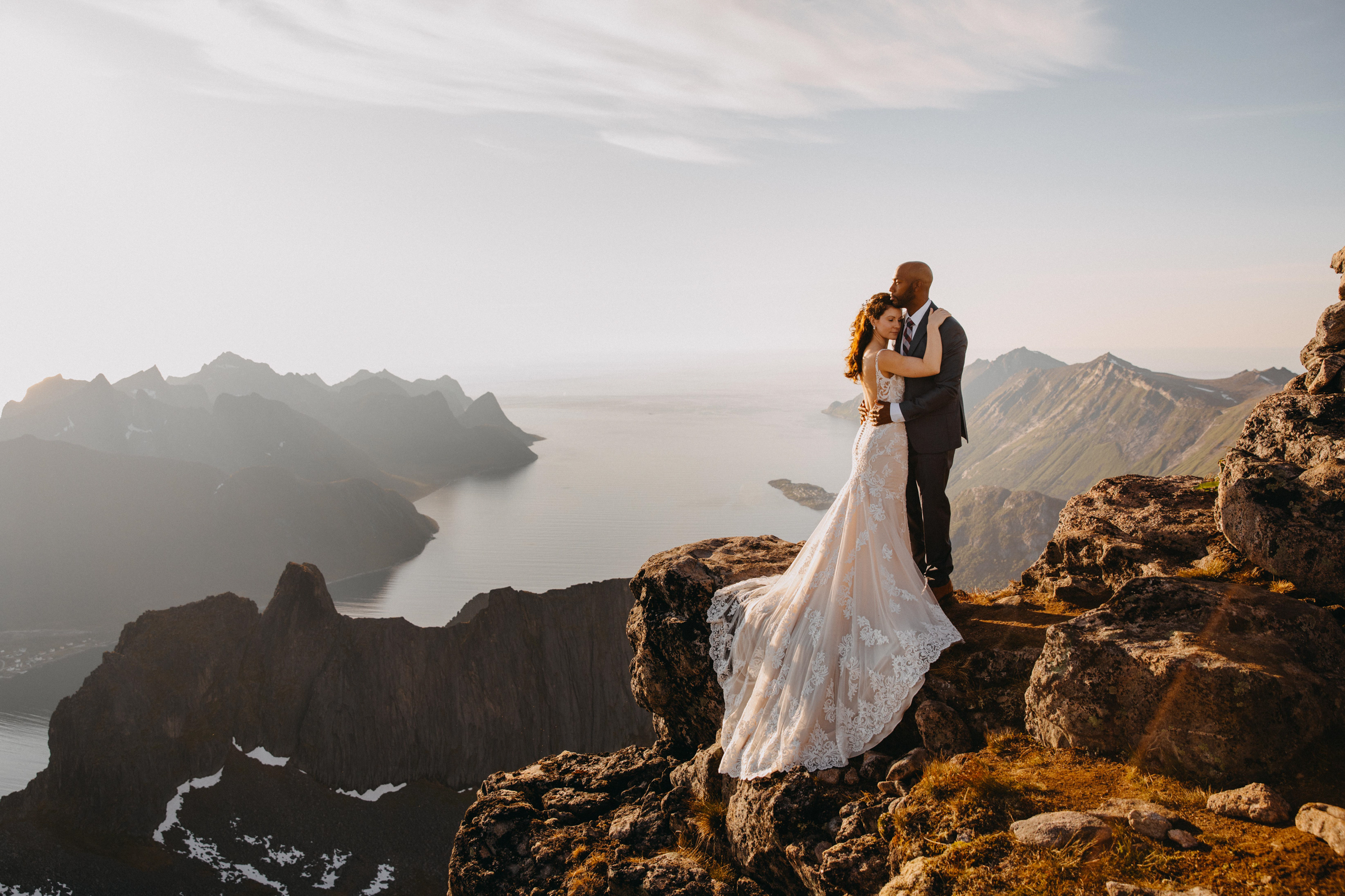 Mountain photo of elopement couple highlighting bride's train at Senja Norway - photo by Christin Eide Photography