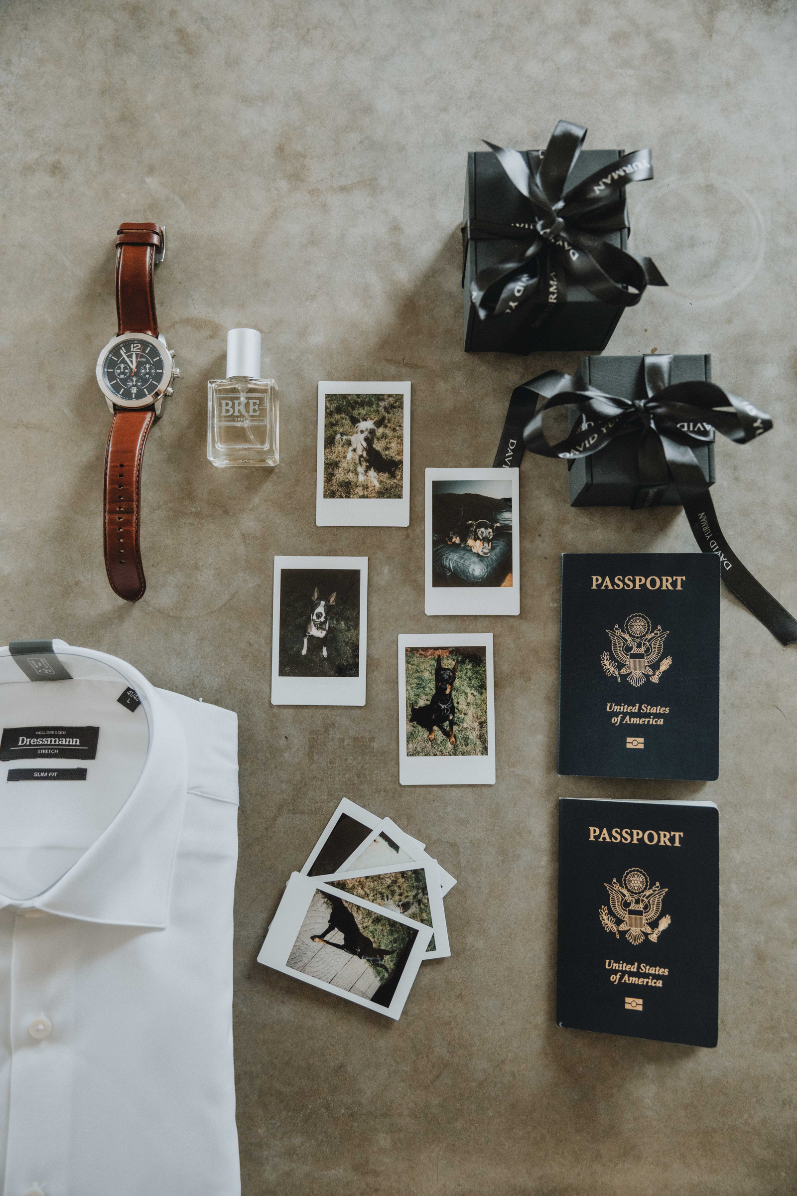 Wedding flatlay of passports, watch, and old photos by Christin Eide Photography in Norway
