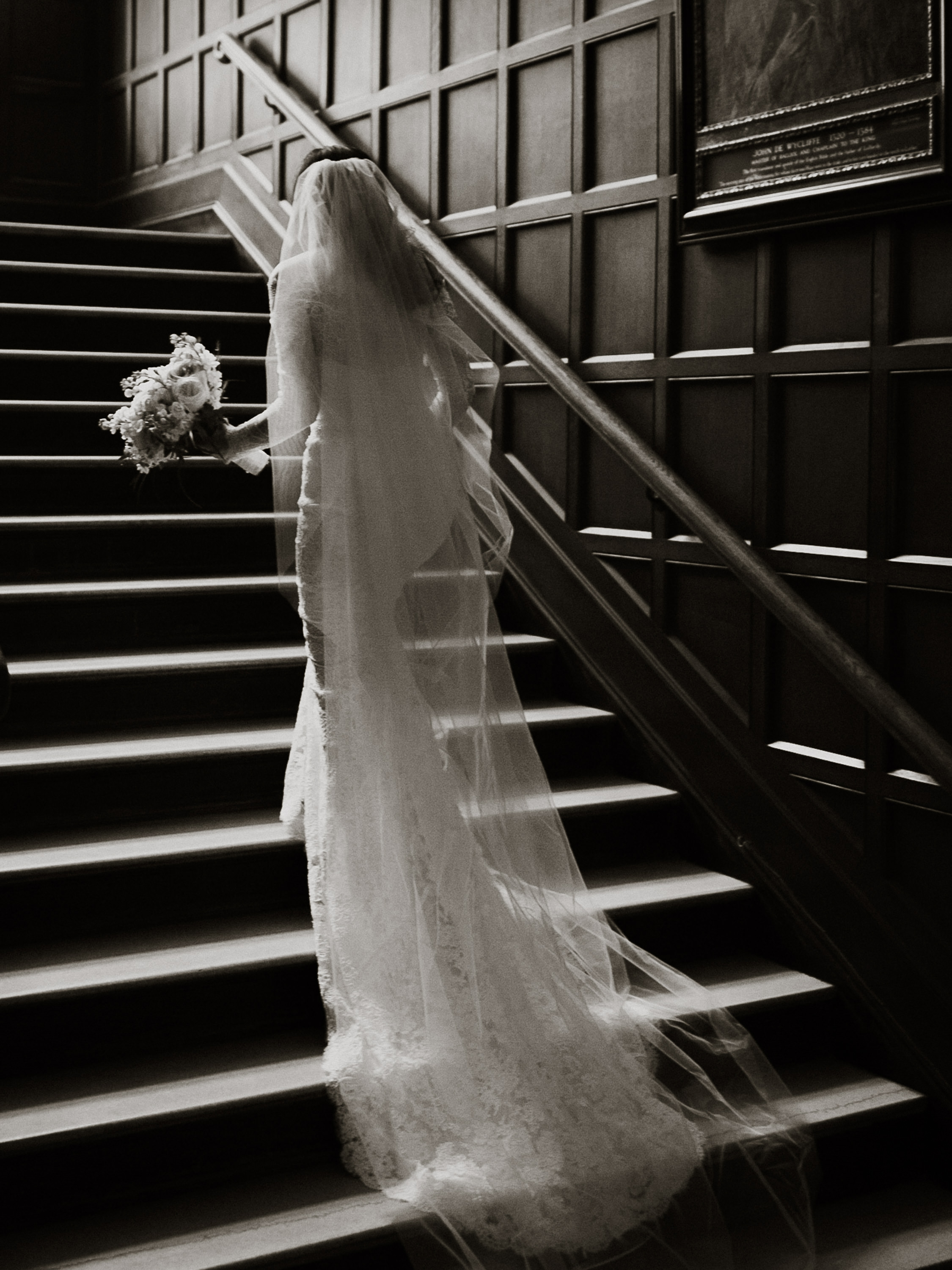 Bride ascending staircase - photo by Joel and Justyna