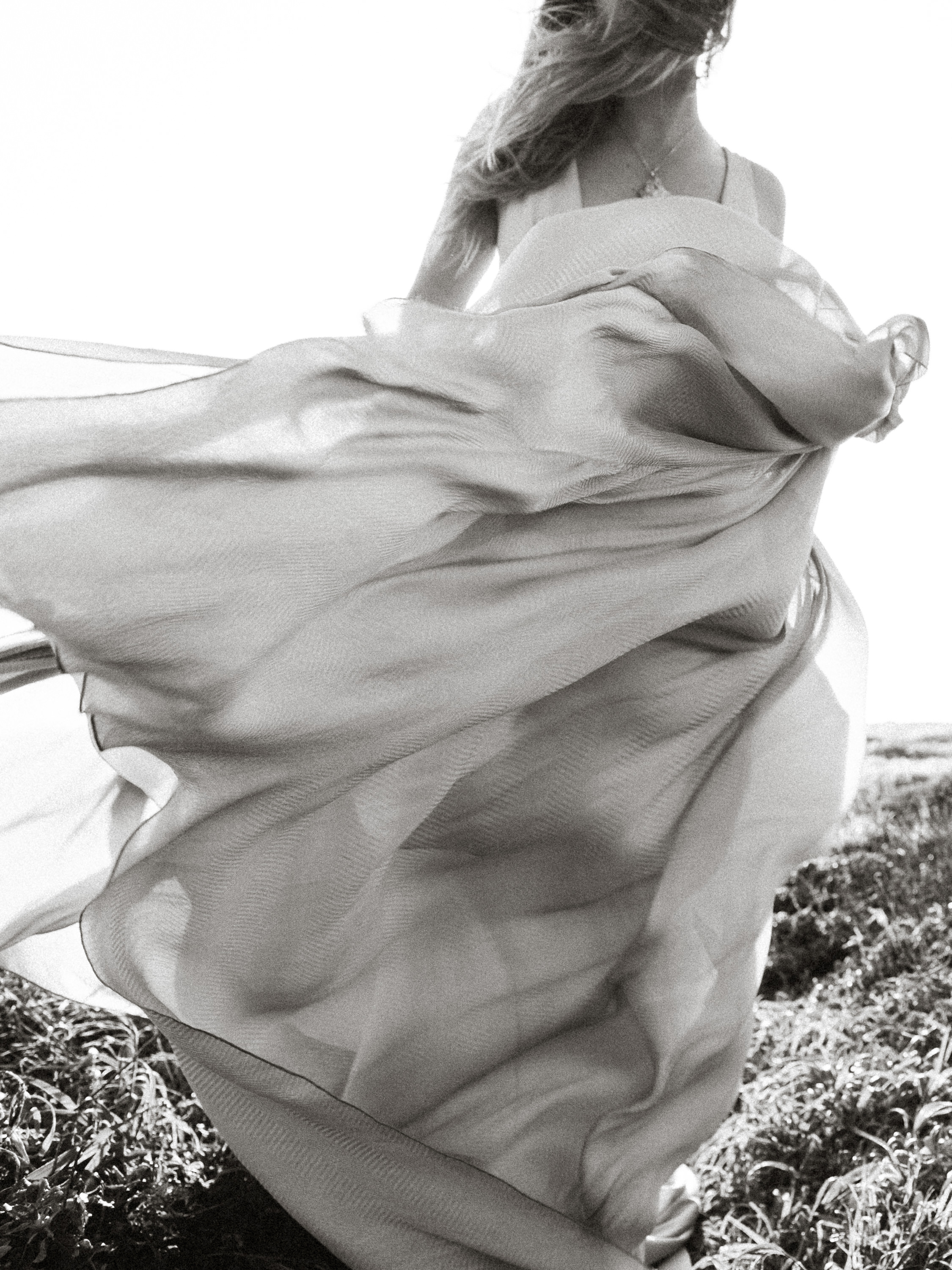 Bride's gown flowing in the wind - photo by Joel and Justyna